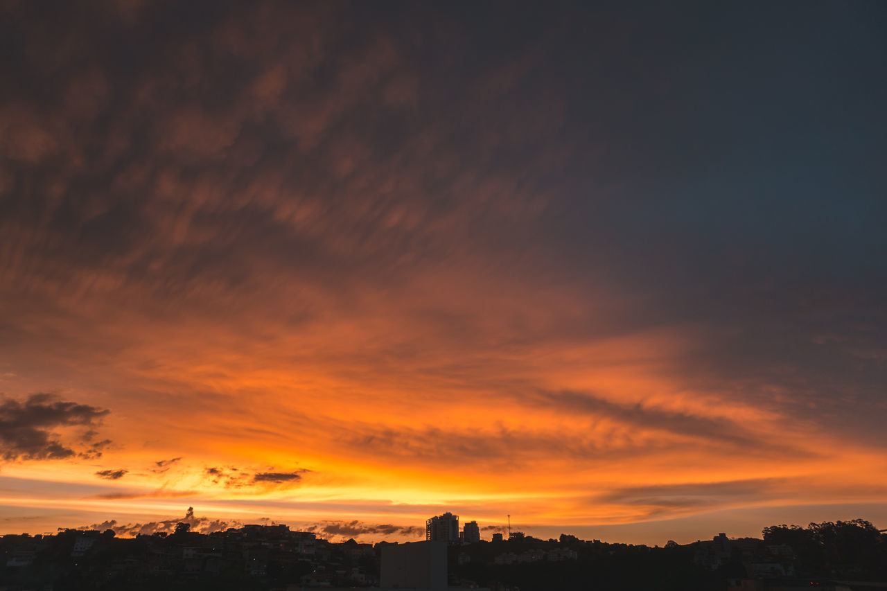sunset, orange color, sky, built structure, cloud - sky, architecture, beauty in nature, no people, building exterior, dramatic sky, scenics, nature, silhouette, tranquility, outdoors, tree, city