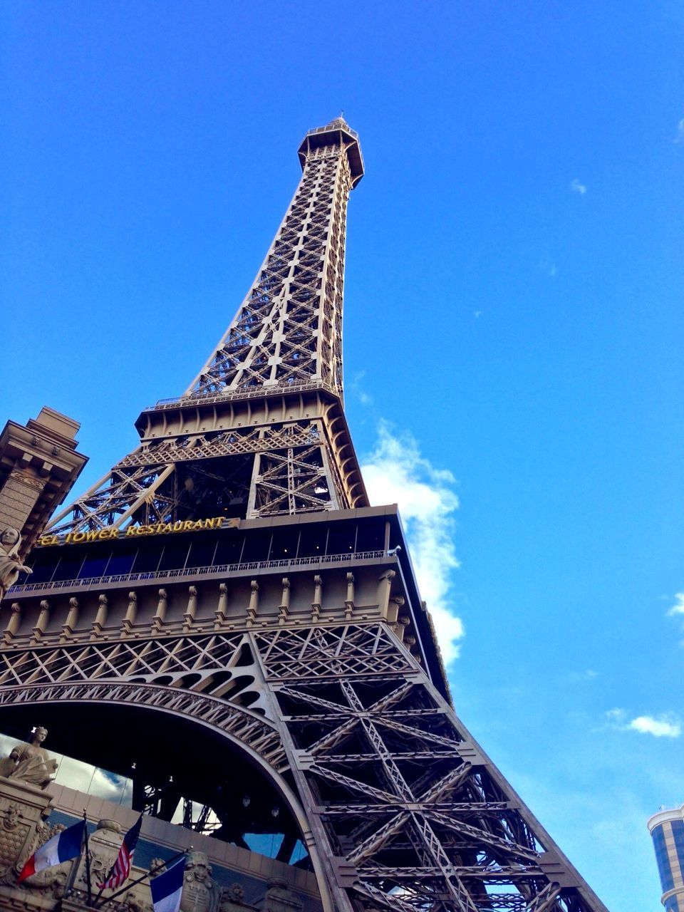 eiffel tower, architecture, famous place, built structure, international landmark, tower, low angle view, tourism, travel destinations, tall - high, capital cities, culture, travel, building exterior, blue, clear sky, history, architectural feature, metal, city