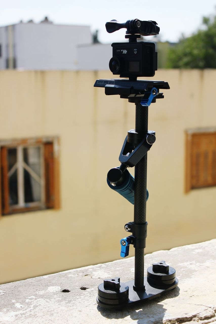 focus on foreground, no people, architecture, close-up, built structure, building exterior, outdoors, day, coin-operated binoculars