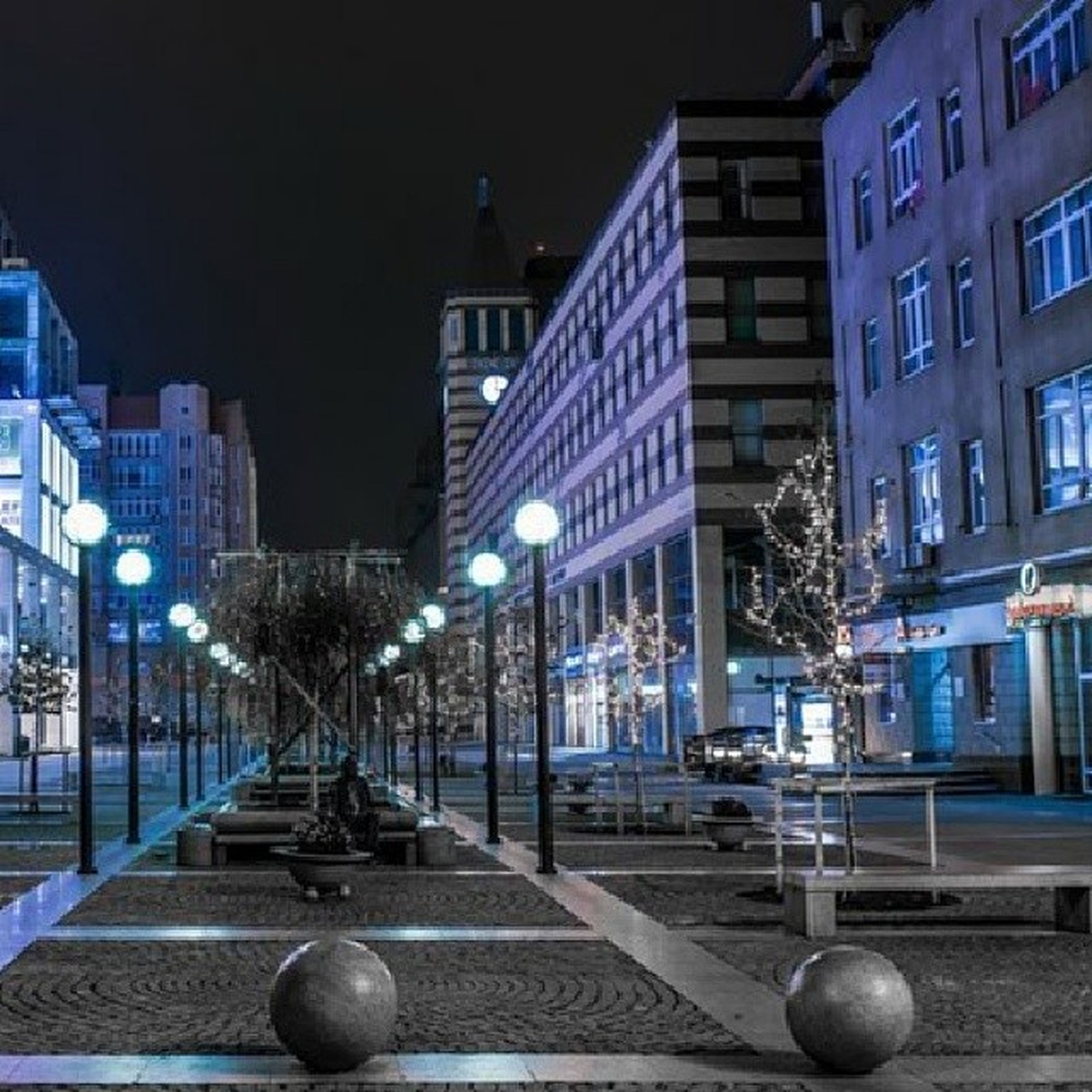 architecture, built structure, building exterior, illuminated, city, night, street light, lighting equipment, sky, street, residential building, building, outdoors, no people, the way forward, residential structure, incidental people, railing, city life, empty