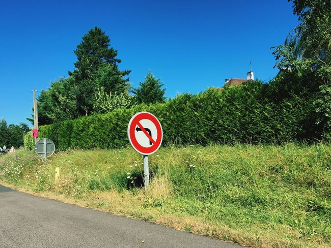 French No-Left-Turn sign No-Left-Turn French France Road Sign Sunny ShotoniPhone6s ShotOnIphone Summer Sunshine Eyeemphoto Attphotos Blue Sky Travel Shot On IPhone 6s