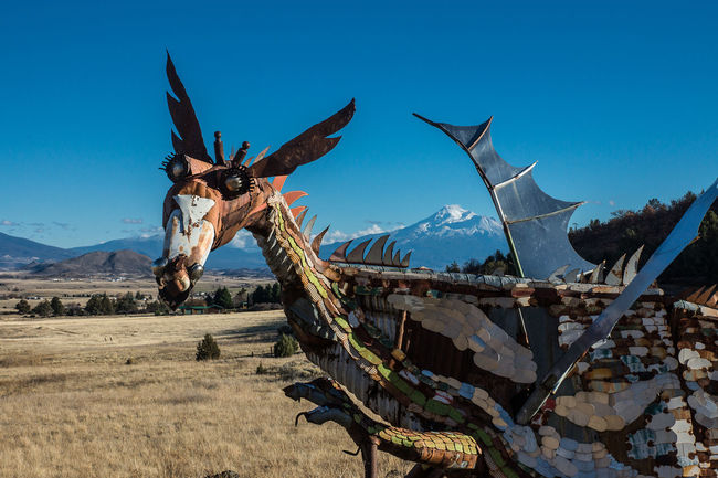 Animal Representation Art Art And Craft Blue California Clear Sky Copy Space Creativity Day Field I Landscape Low Angle View Metal Mount Semeru Mountain Nature No People Outdoors Roa A Sculpture Sky Sunlight Whimsical Wings