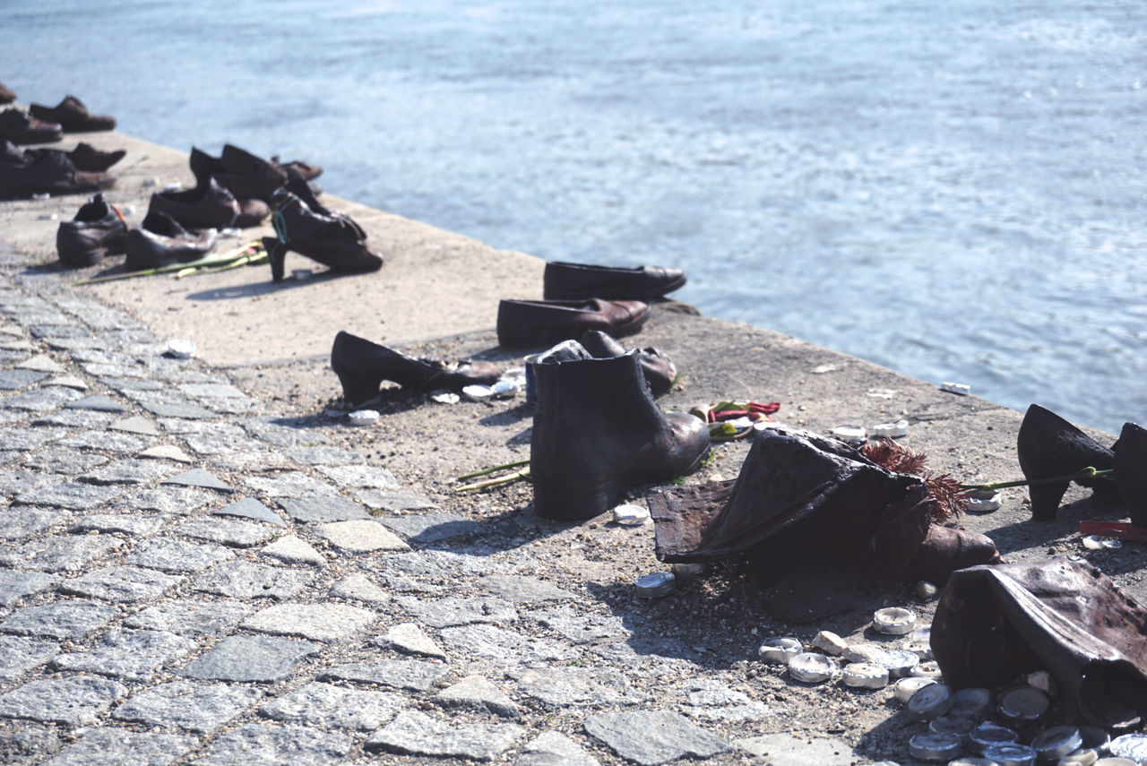 On the Danube [Budapest] // Shoes on the Danube // Sony a6000 // Budapest Budapest, Hungary Day Historical History Jewish Jewish Memorial Memorial No People Outdoors Rememberance River Riverbank Riverside Shadow Shoes Shoes On The Danube Bank Sony A6000 Statue Sunlight This Week On Eyeem Tranquility Water Ww2 WWII The Street Photographer The Architect - 2017 EyeEm Awards The Great Outdoors - 2017 EyeEm Awards The Street Photographer - 2017 EyeEm Awards The Photojournalist - 2017 EyeEm Awards Neighborhood Map BYOPaper! Place Of Heart