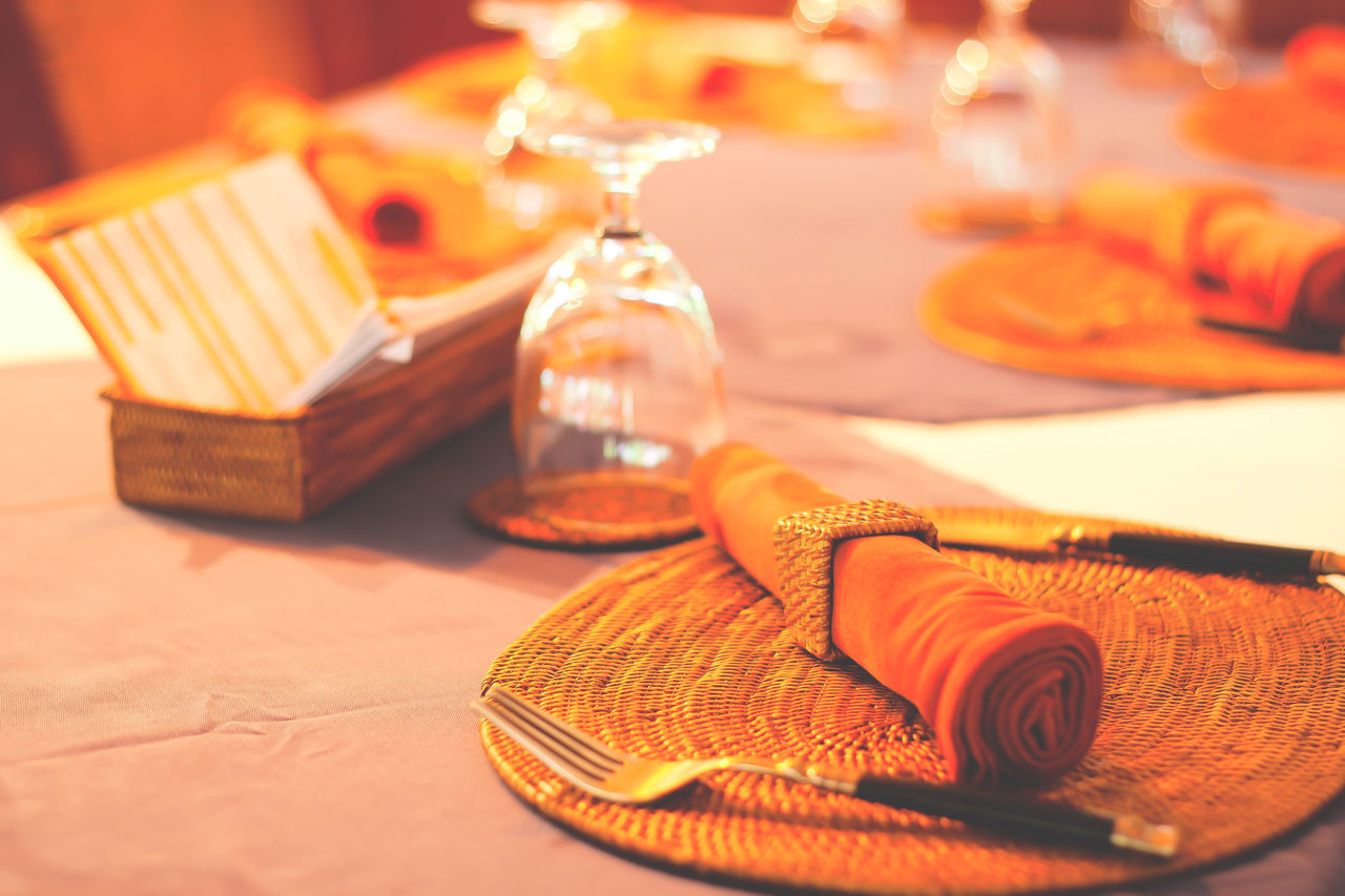 Dinner set decoration on table in restaurant Close-up Day Decoration Decorative Dinner Dinner Table Dinner Time Food And Drink Goal Indoors  Lifestyles Luxury Meal Napkin Napkin Holder No People Orange Color Restaurant Style Stylish Table
