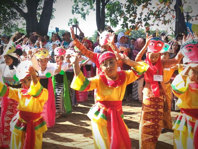 2). Dancing under the morning sun | Colosal Sunday Mass Kids Dance Gathering Observing People Traditional Culture Cultural Dance On Street Traditional Costume in Jakarta, Indonesia