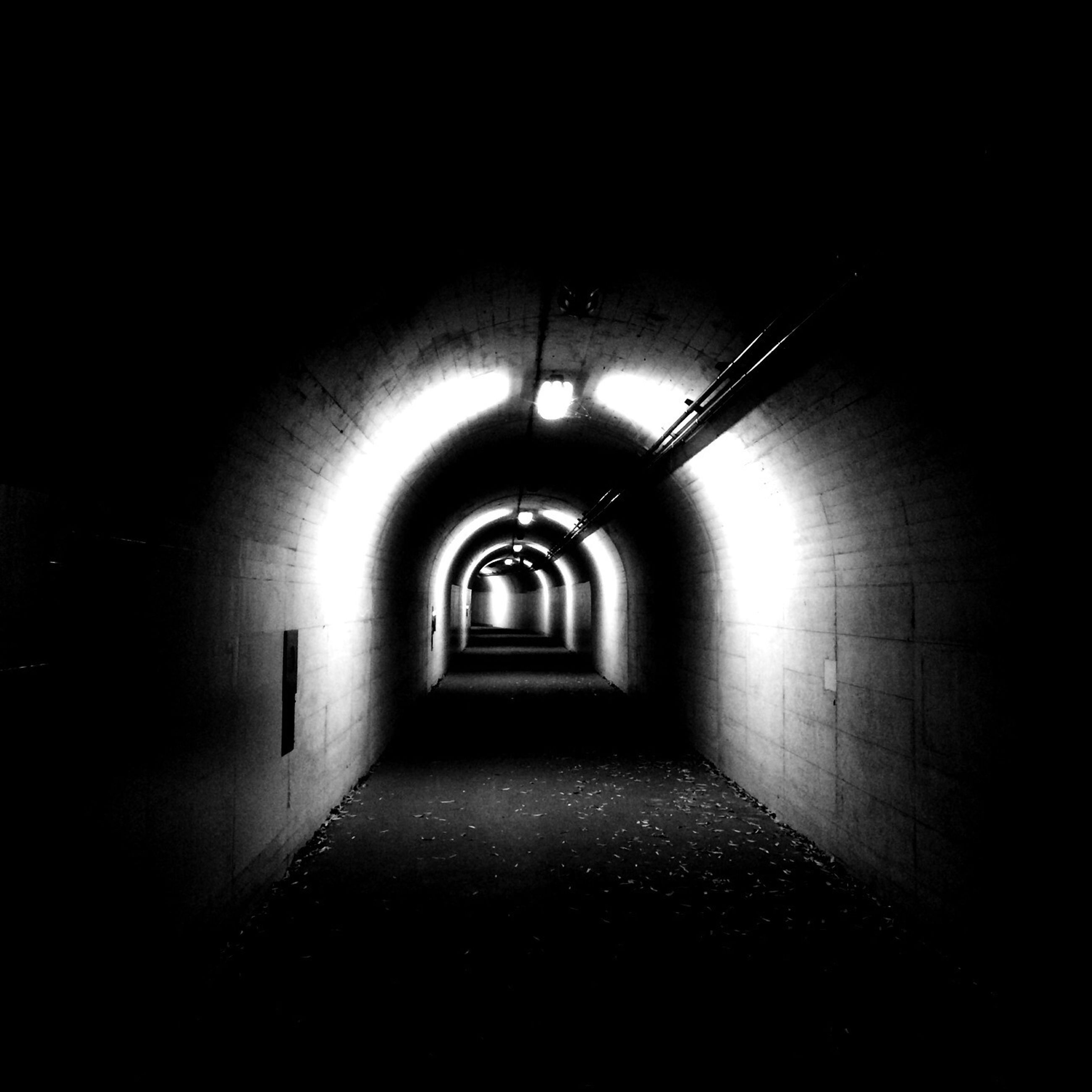 the way forward, indoors, tunnel, architecture, illuminated, diminishing perspective, built structure, corridor, arch, vanishing point, empty, wall - building feature, narrow, light at the end of the tunnel, lighting equipment, wall, long, absence, building, ceiling