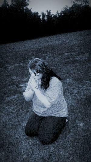 Praying in a feild Long Hair One Person Grass Sitting Nature Prayer GodBless Forgive Me  Forgiving