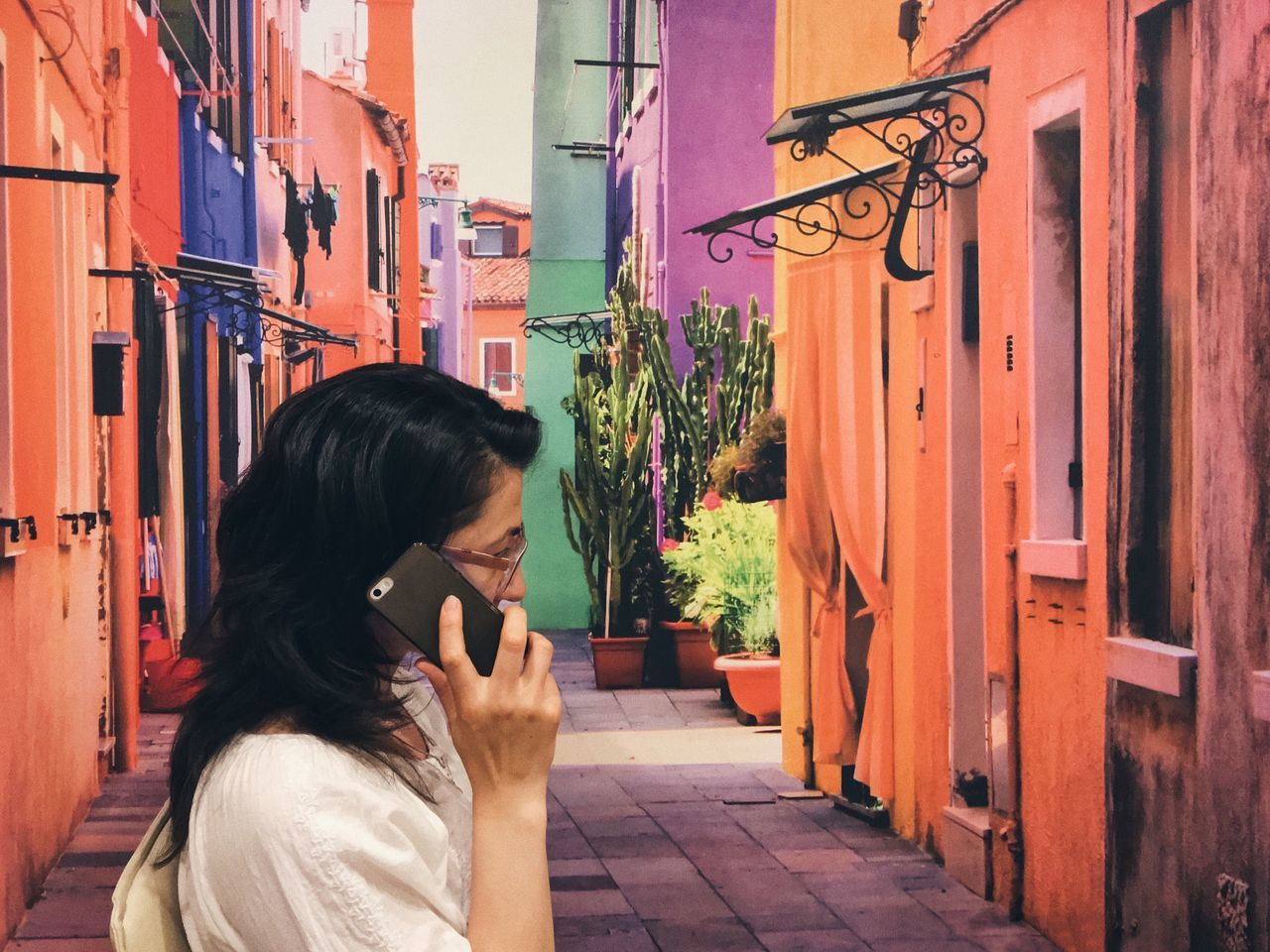 Conversations... Communication Building Exterior Architecture Built Structure Real People Outdoors Women Lifestyles Smiling Wireless Technology City Day Technology Young Adult Adult People Colorful VSCO Mobile Fashion Freshness Summer Details Of My Life Street Conversation