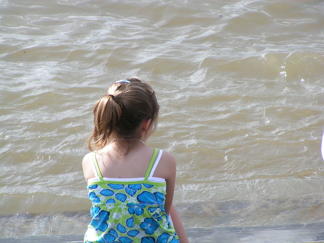 Beach Child Childhood Children Only Day Nature One Girl Only One Person Outdoors People Rear View Sand Sea Summer Swimming Tourism Tourist Travel Destinations Vacations Waist Up Water Wave Wet New Orleans Waterfront New Orleans