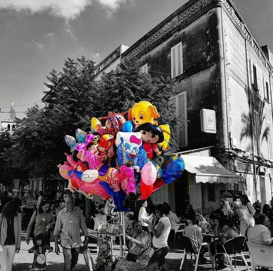 We are a balloon filled with emotions, in a world full of pins... Balloon Balloons Black And White And Color Blackandwhite Black & White Life City City City Life City Street Black And White People People Photography Multi Colored Outdoors Day First Eyeem Photo