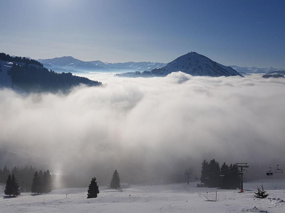 clouds over mountains Scheffau Austria Ski Resort  Clouds And Sky Low Clouds Mountain Mountain View Alps Alpine Mountain Range Above The Clouds Clouds Winter Mountain Fog Cold Temperature Snow Outdoors Winter Nature Sky