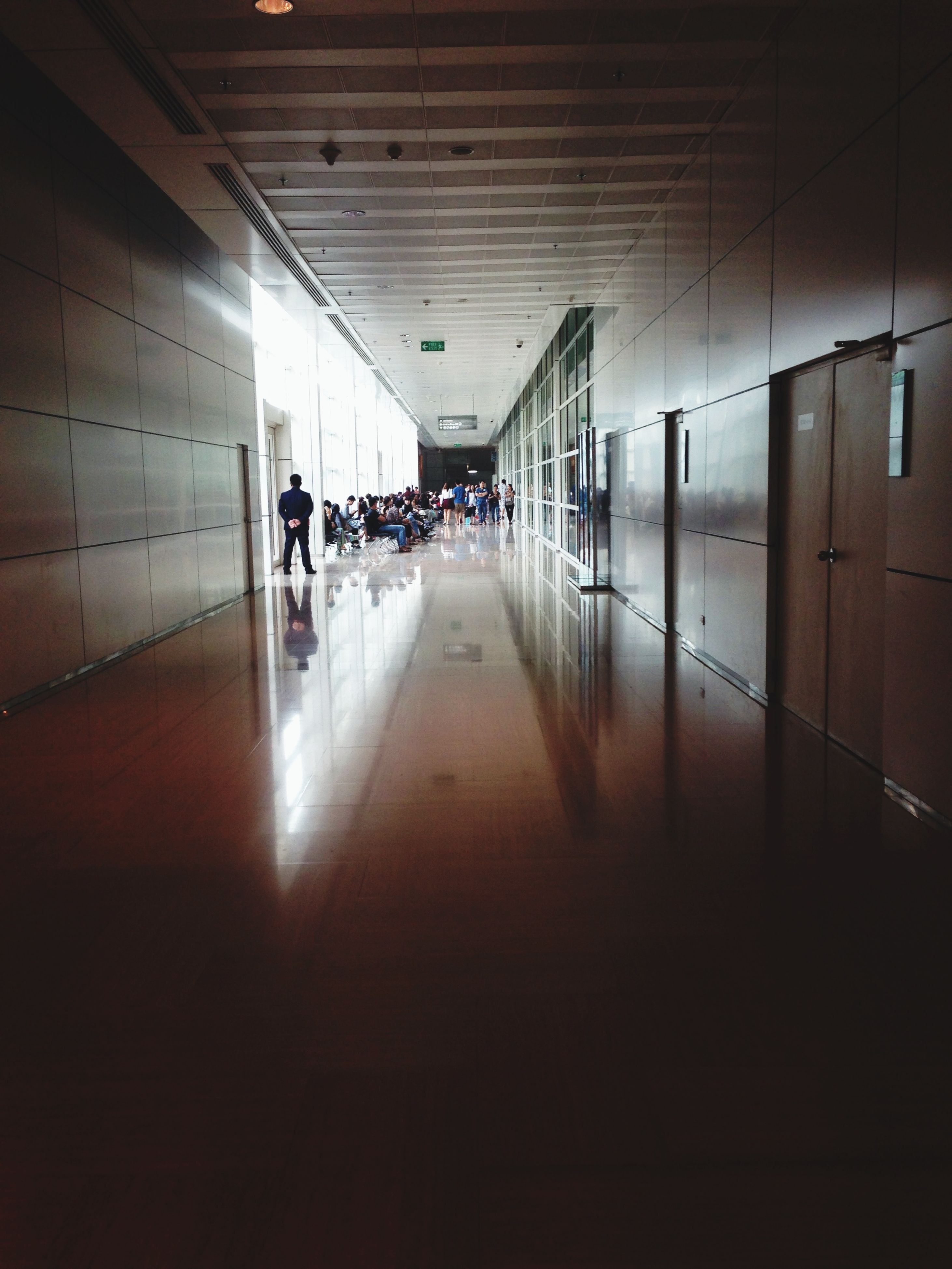 indoors, architecture, built structure, the way forward, illuminated, empty, corridor, ceiling, building, transportation, flooring, narrow, diminishing perspective, interior, incidental people, in a row, absence, window, reflection, lighting equipment