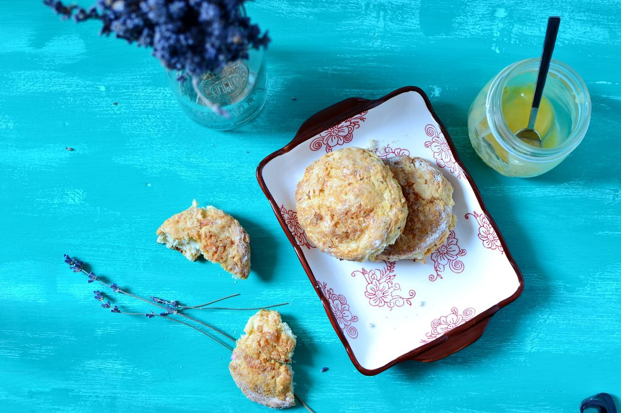 Apple and cheddar cheese scones, lemon curd, dried lavender flowers Wooden Tabletop Appetizer Bright Colors Baked Food Photography Scones Traditional Food Lemon Curd Freshly Baked Dried Flowers Home Food Sweet Food Dessert Foodphotography Home Baked Blue Visual Feast BYOPaper!