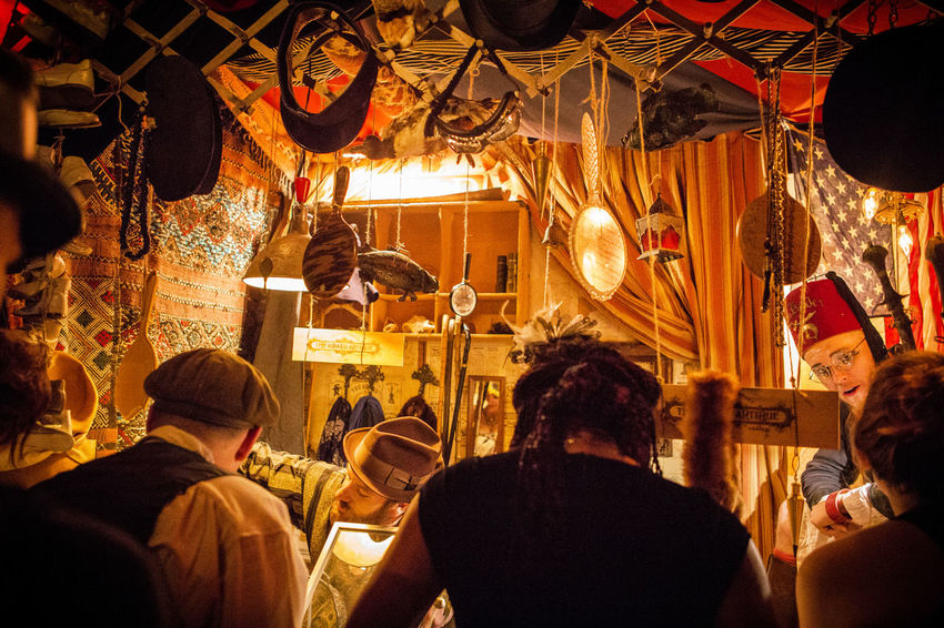 Edwardian Ball merchandise Art And Craft Art Festival Back View Costume Costume Party Costumes Edwardian Ball Entertainment Fantastical Fantastical And Magical Hat Shop Merchant Mirrors Olden Days Orange Color Orange Light Period Clothing Steam Punk Up Close Street Photography Telling Stories Differently Human Meets Technology