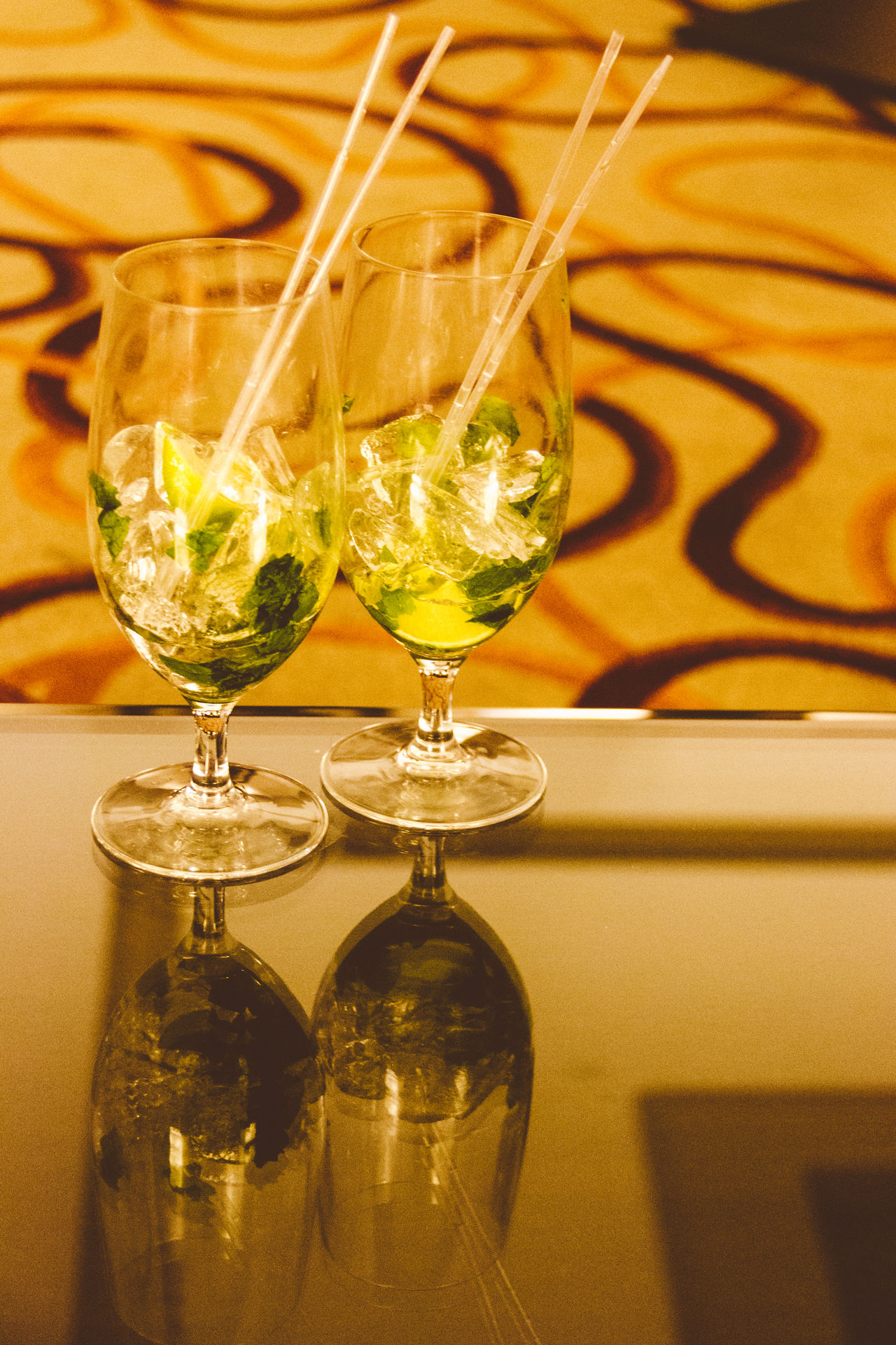 Alcohol Cocktail Date Drink Drinking Glass Empty Fancy Glasses Ice Indoors  Lime Luxury Mint Mojito Night Out No People Reflection Relaxing Straws Together Two