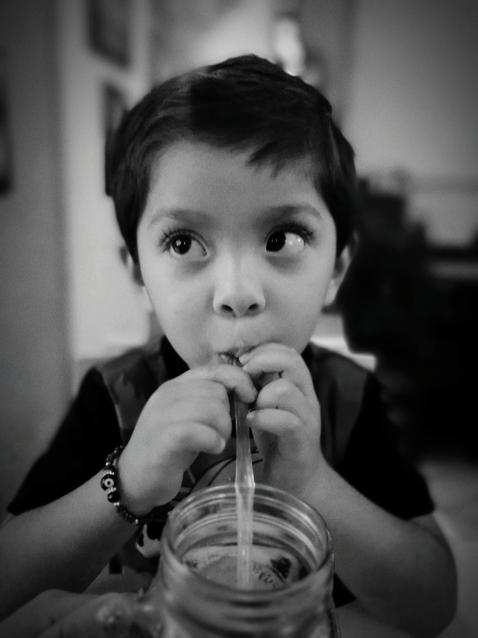Boy Sipping Drink At Home