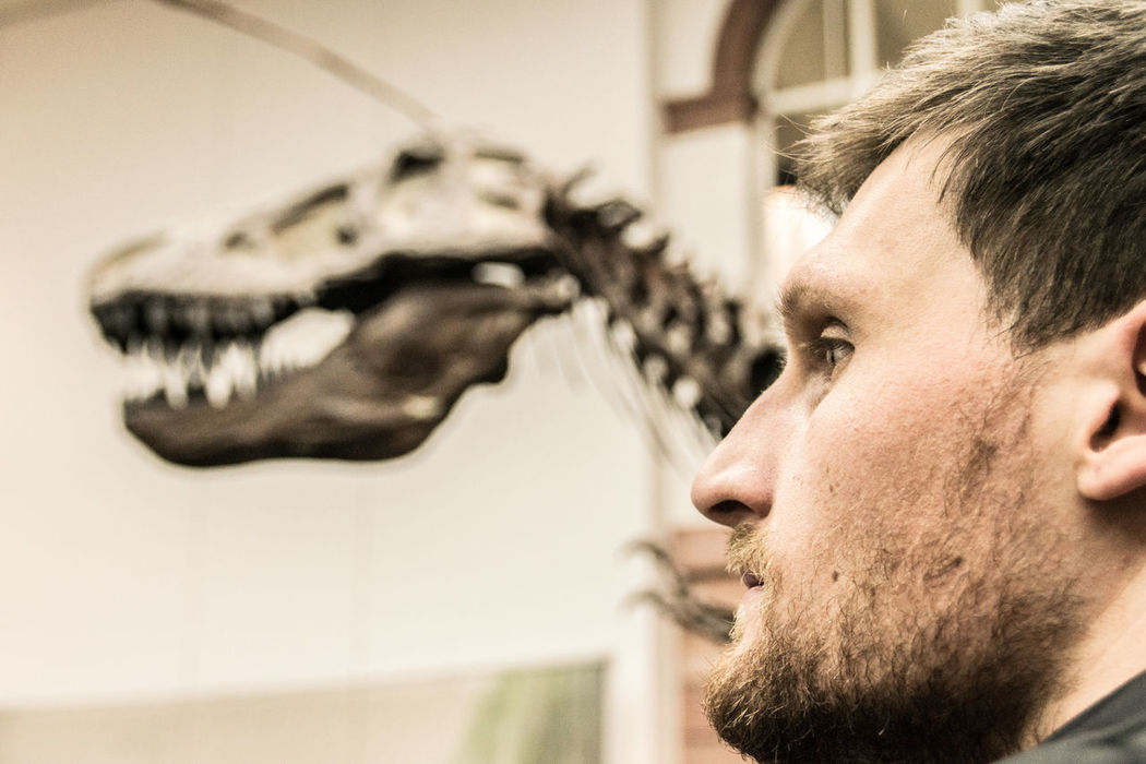 You've come a long way, baby! Archeology Beard Bearded Close-up Confidence  Dino Dinosaur Dinosaurs Evolution  This Week On Eyeem Historical Museum Human Human Face Mid Adult Museum One Person Prehistoric Profile Selective Focus Serious Skeleton Visiting Museum Visitor Young Adult Young Men