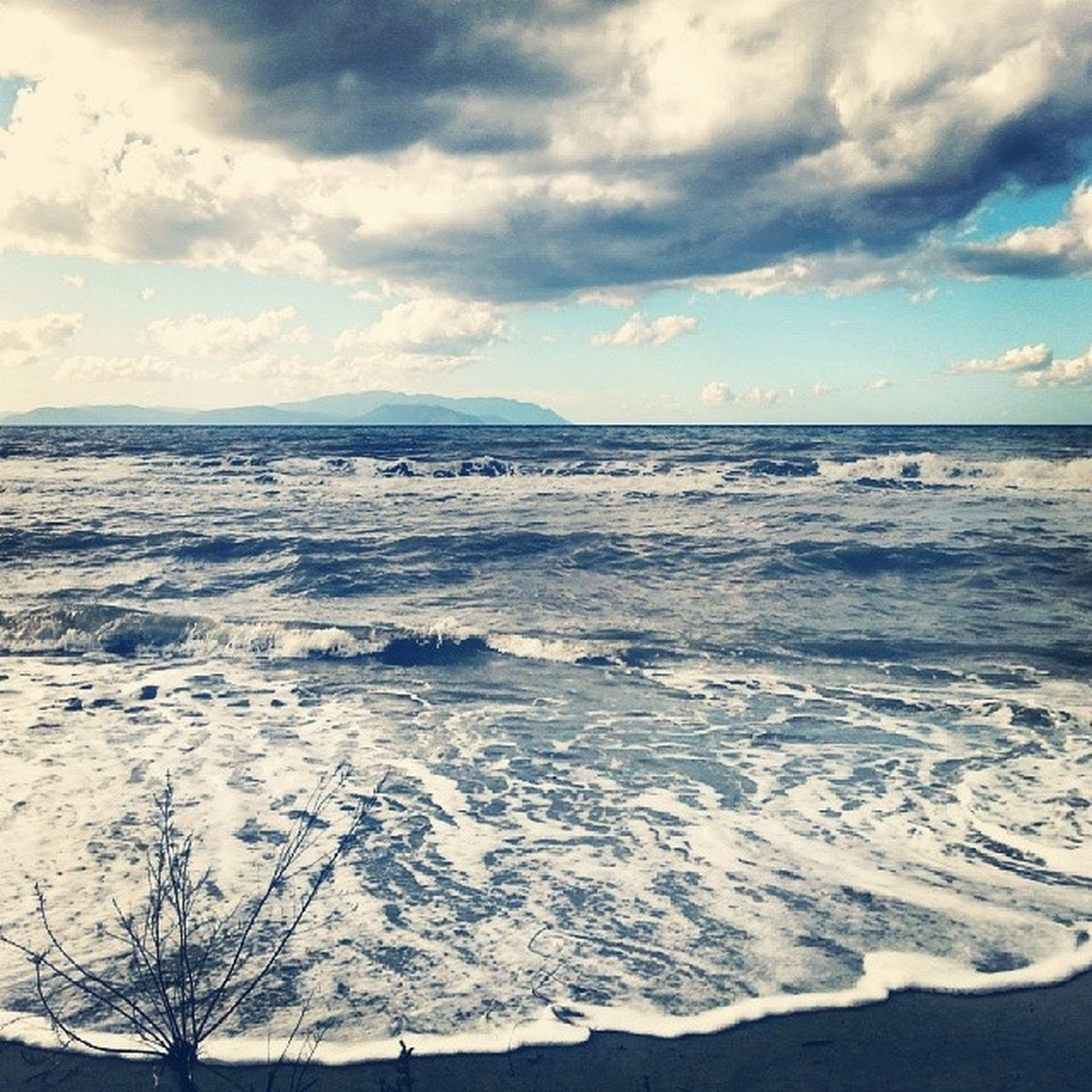 sky, tranquil scene, scenics, tranquility, beauty in nature, cold temperature, snow, water, sea, winter, cloud - sky, nature, weather, cloudy, cloud, idyllic, season, beach, horizon over water, non-urban scene