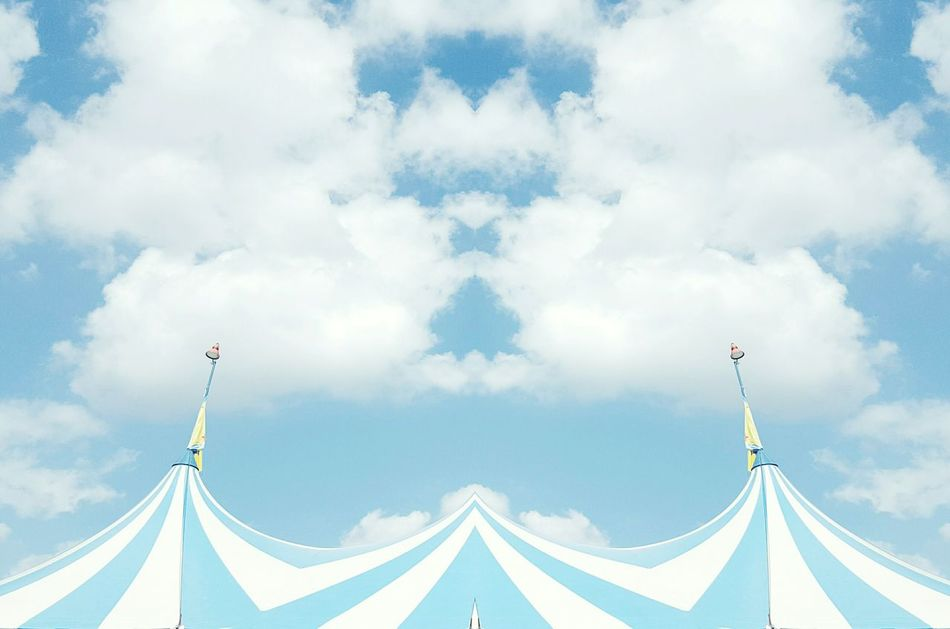I see faces The Innovator Clouds And Sky I See Faces Tent Blue And White Stripes Pattern Circus Architectural Detail In Town Full Frame No People Creating Art Symmetrical Architecture Symmetry Lookingup Playing With Apps  Creativity Big Top Shades Of Blue Summer Icecream Color Feel The Journey EyeEm Best Shots Outdoors Showcase June