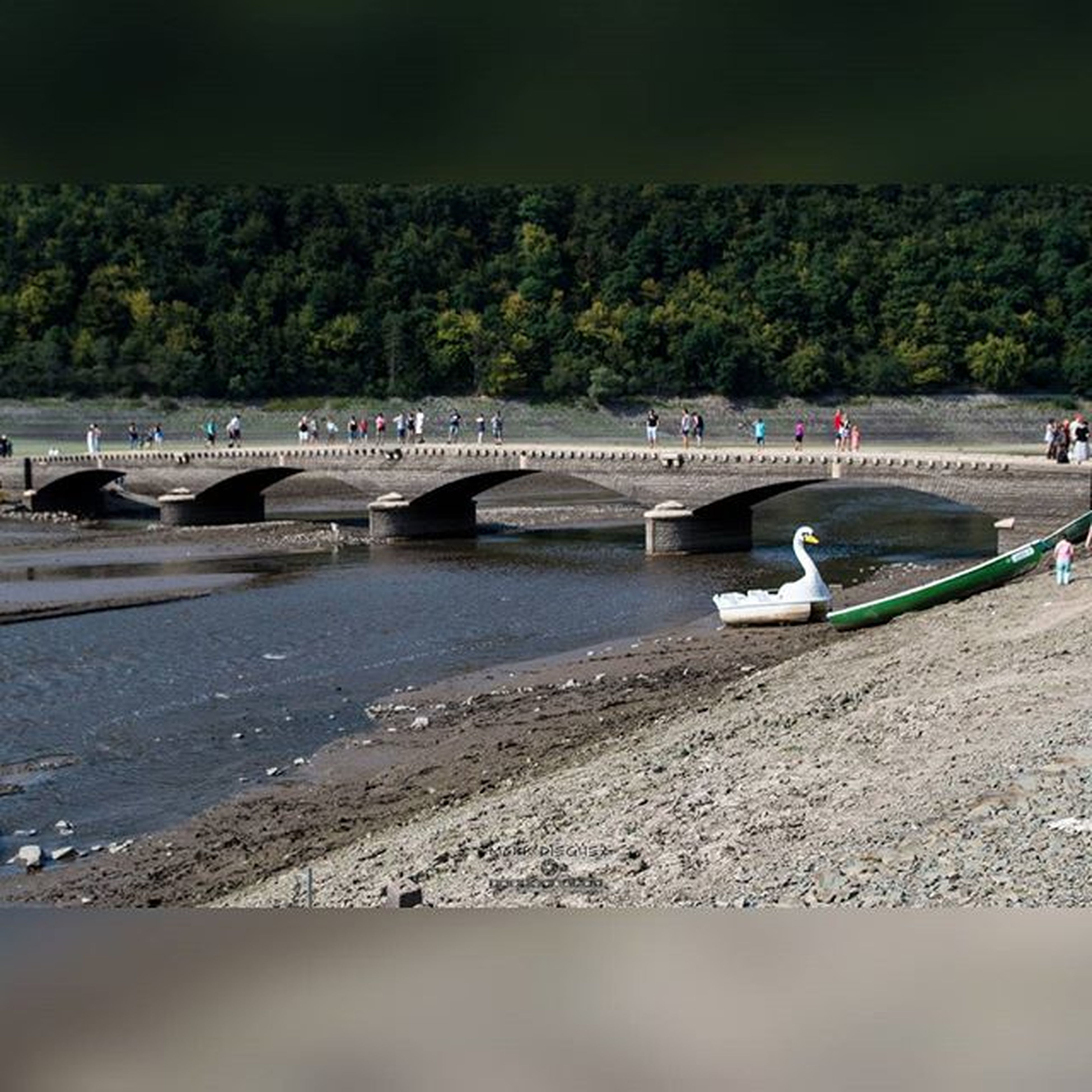transportation, bridge - man made structure, connection, built structure, river, water, architecture, bridge, beach, mode of transport, tree, high angle view, road, city, incidental people, engineering, sand, outdoors, travel, nautical vessel