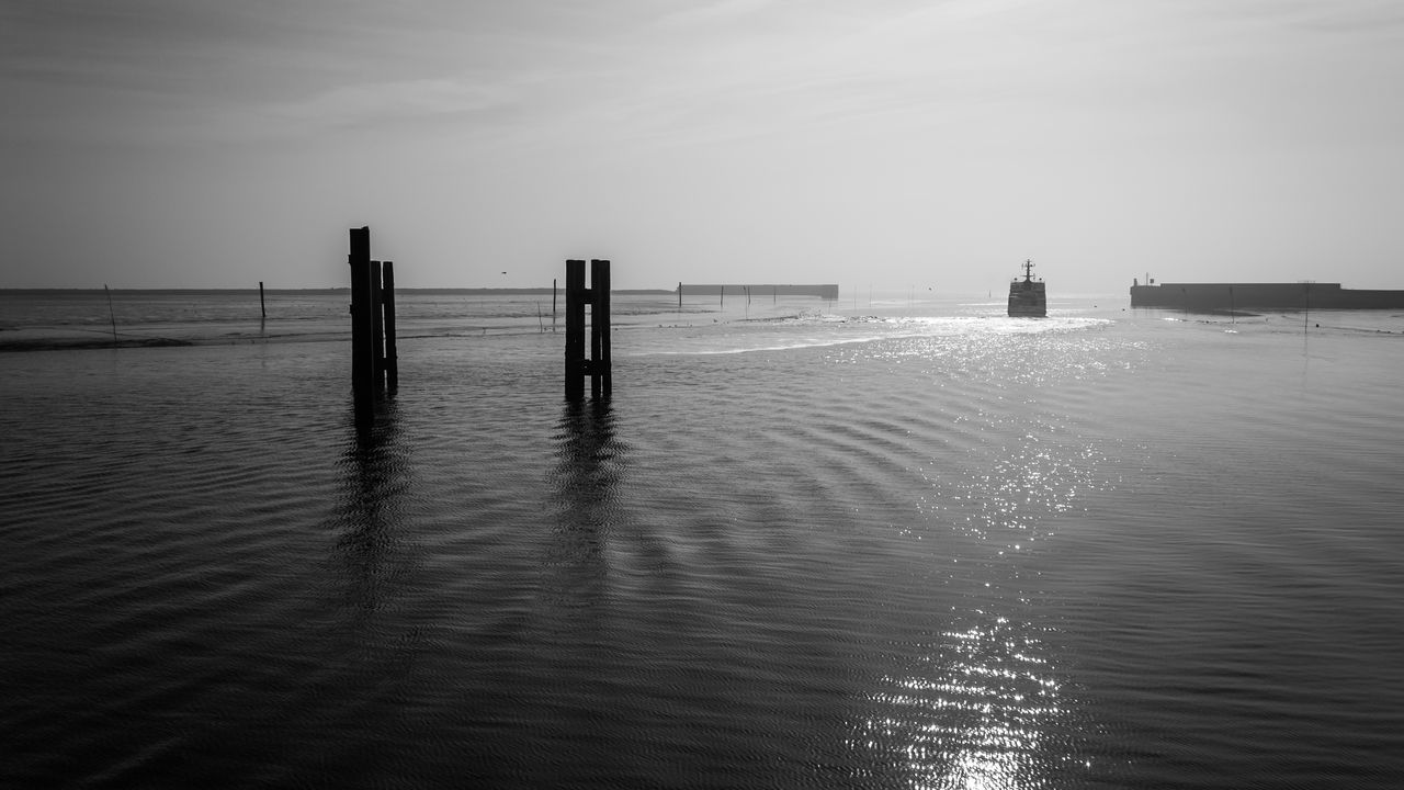 Beauty In Nature Blackandwhite Blackandwhite Photography Day Ferryboat Goodbye Harbour Horizon Over Water Langeoog Nature No People Northsea Outdoors Reflections Sea Seascape Sky Tranquility Water