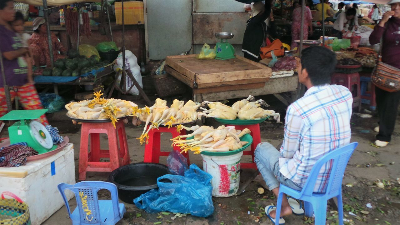 Battanbang Cambodia Chicken Chickens Commerce Food For Sale Fresh Local Market Market Market Stall Meat Real People Small Town Vendor Working Men At Work  Underdeveloped Society Economy Asian Culture