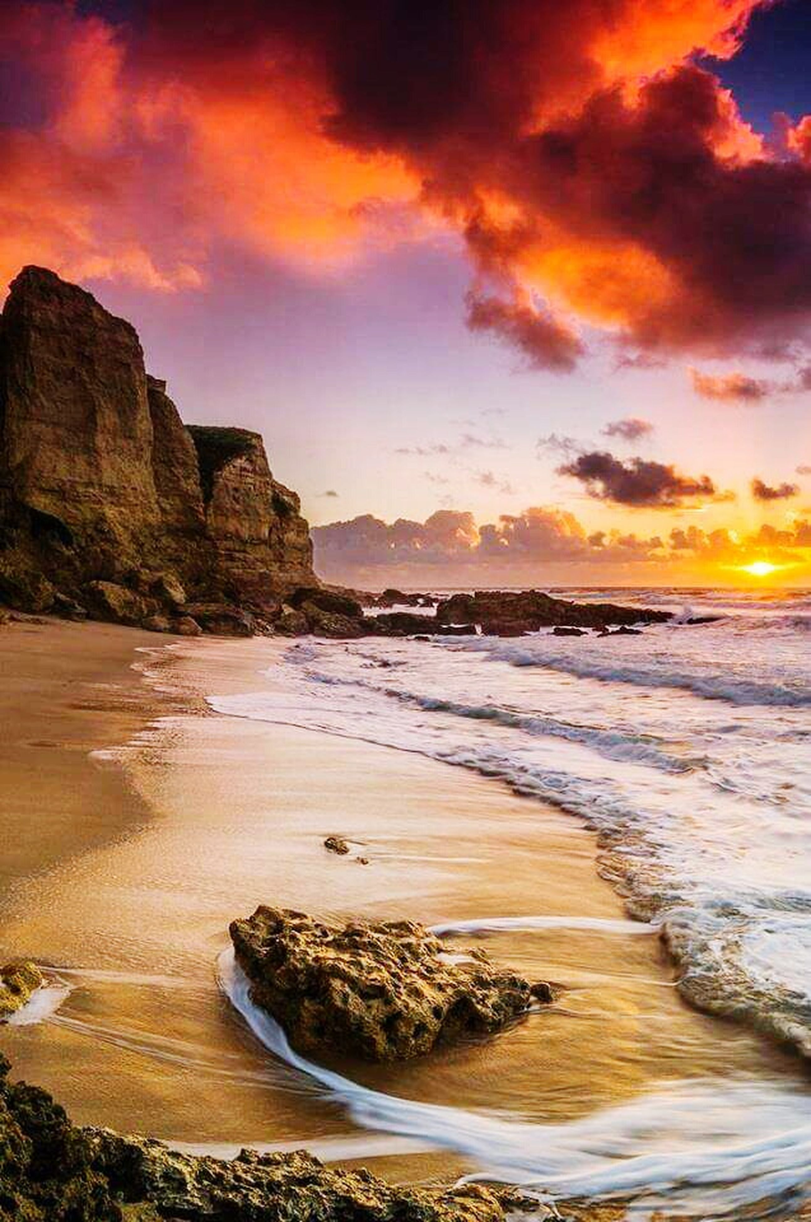 sea, water, beach, sunset, scenics, beauty in nature, sky, shore, tranquil scene, tranquility, horizon over water, cloud - sky, wave, nature, rock - object, idyllic, orange color, sand, surf, rock formation