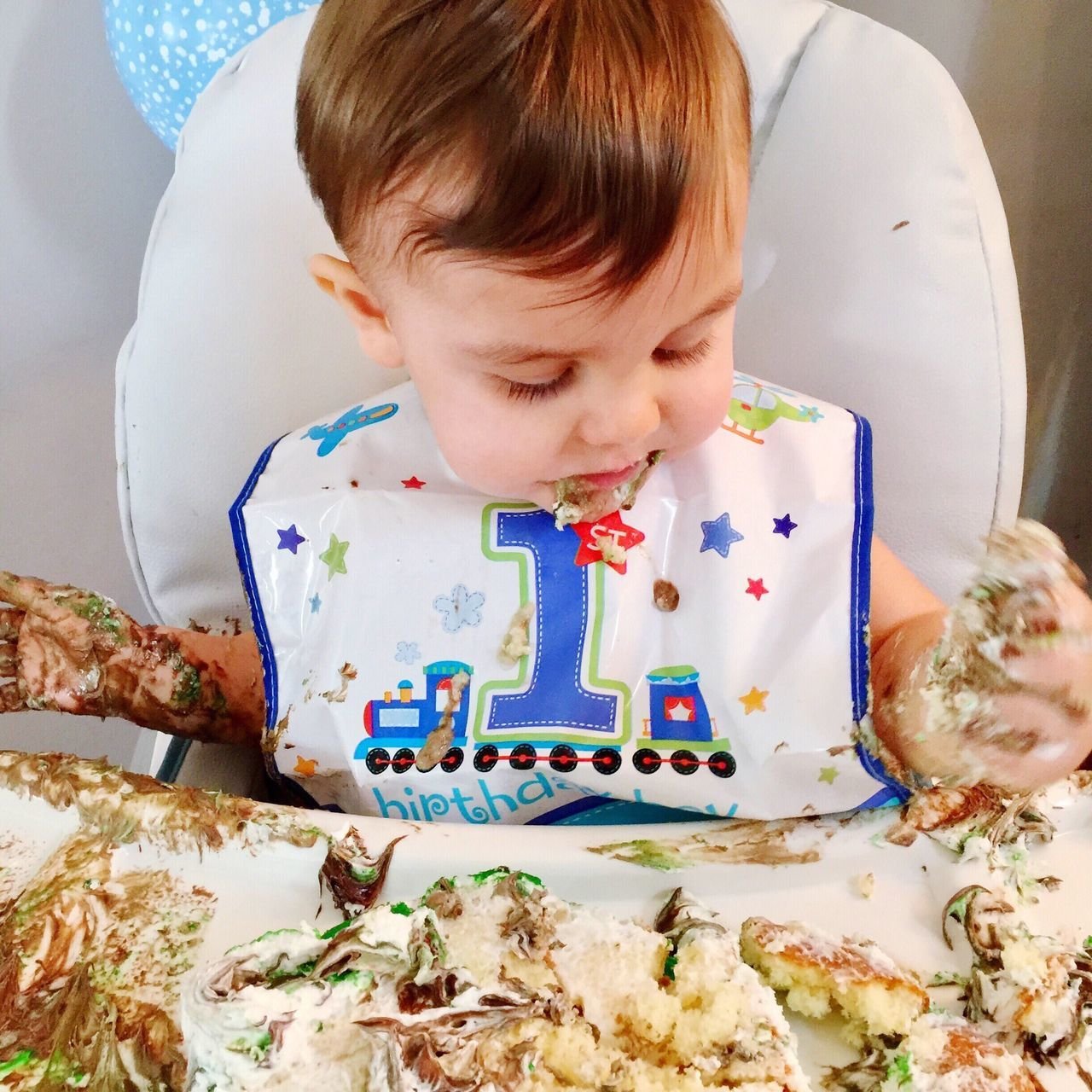 Just had his first birthday and happily destroyed his first birthday cake. Now he was trying to shake the frosting off of his hands and quietly contemplating the mess he made. @Hans_Walter I think the dog ate the party hat. Many years ago I started taking photos using black and white film and developing the photos myself in the dark room. Even just a few years ago I never would have believed that I would take a photo with a cell phone and then post it to Eye Em. Now I have posted 1,000 of them. Times have changed. Authentic Moments Enjoy The New Normal What Who Where Sweet Food Portrait Boy Real People Indoors  Childhood Birthday Cake One Person Food Day Close-up Text Food And Drink Temptation Toddler  Thank you all for your support the past few years. I look forward every day to seeing all of your photos.