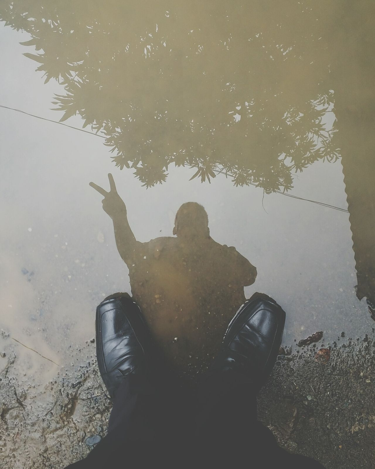 """Be kind to your knees, you'll miss them when they're gone"" -Bas Luhrmann (wear sunscreen) Water Reflection Low Section Puddle Person Lifestyles Footwear Leisure Activity High Angle View Day Standing Water Human Foot Outdoors Personal Perspective Sky Tranquility Nature Collection Eyeem Philippines EyeEm Feet Shoes Leather"