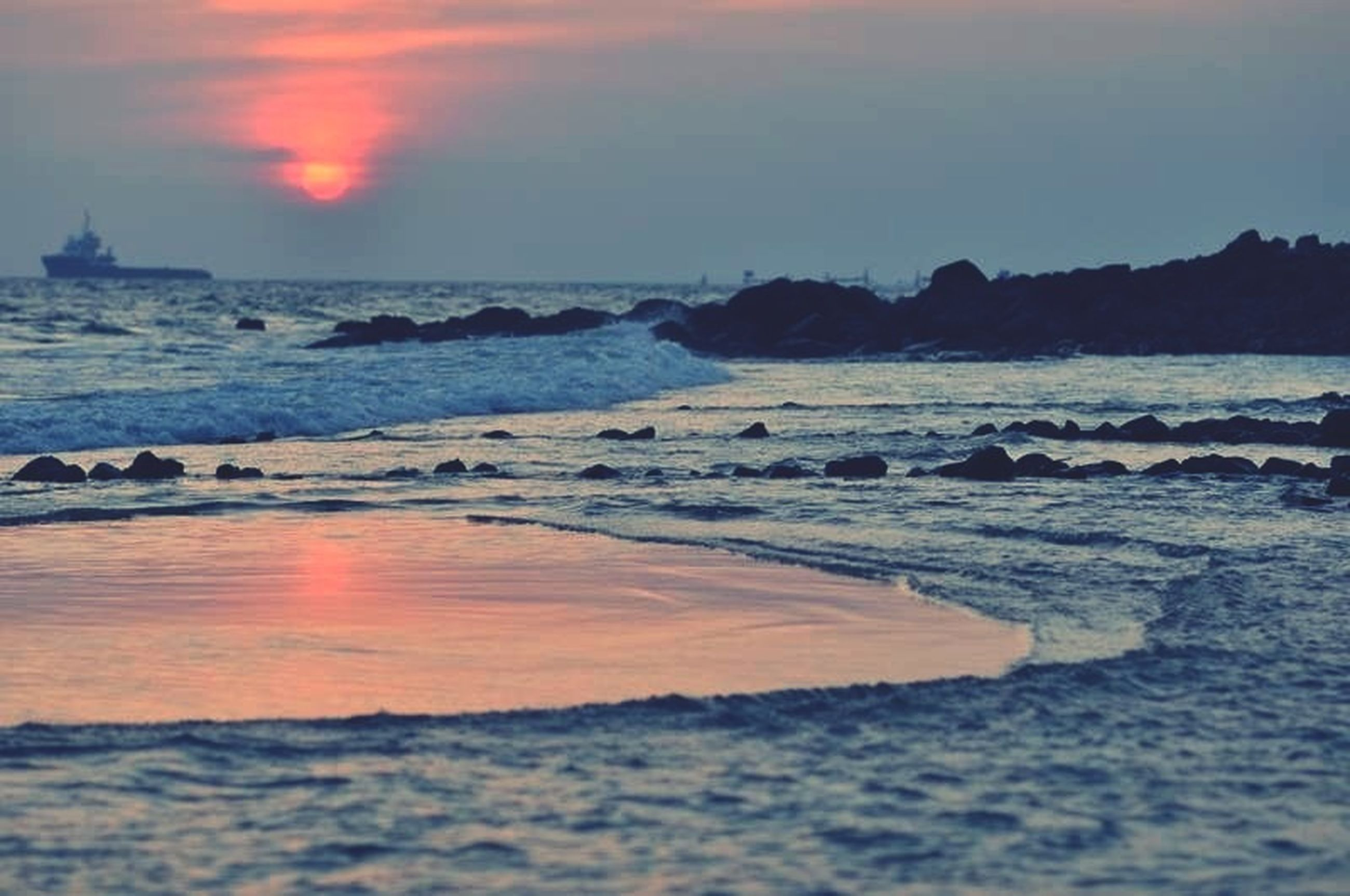 sea, water, sunset, horizon over water, beach, scenics, tranquil scene, beauty in nature, tranquility, sky, shore, wave, nature, idyllic, rock - object, surf, orange color, coastline, remote, outdoors