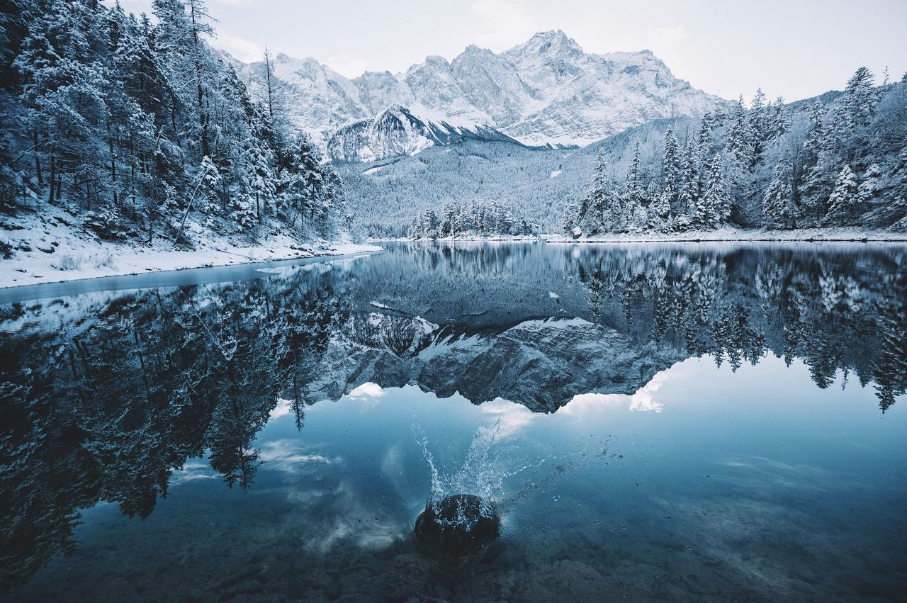 Winter is back in Bavaria - Germany. Vscofilm Bavaria Alps Wilderness Reflection Lake Mountain Water Nature Beauty In Nature Snow Mountain Range Scenics Cold Temperature Tree Tranquility Tranquil Scene Outdoors Winter Landscape No People Sky Day