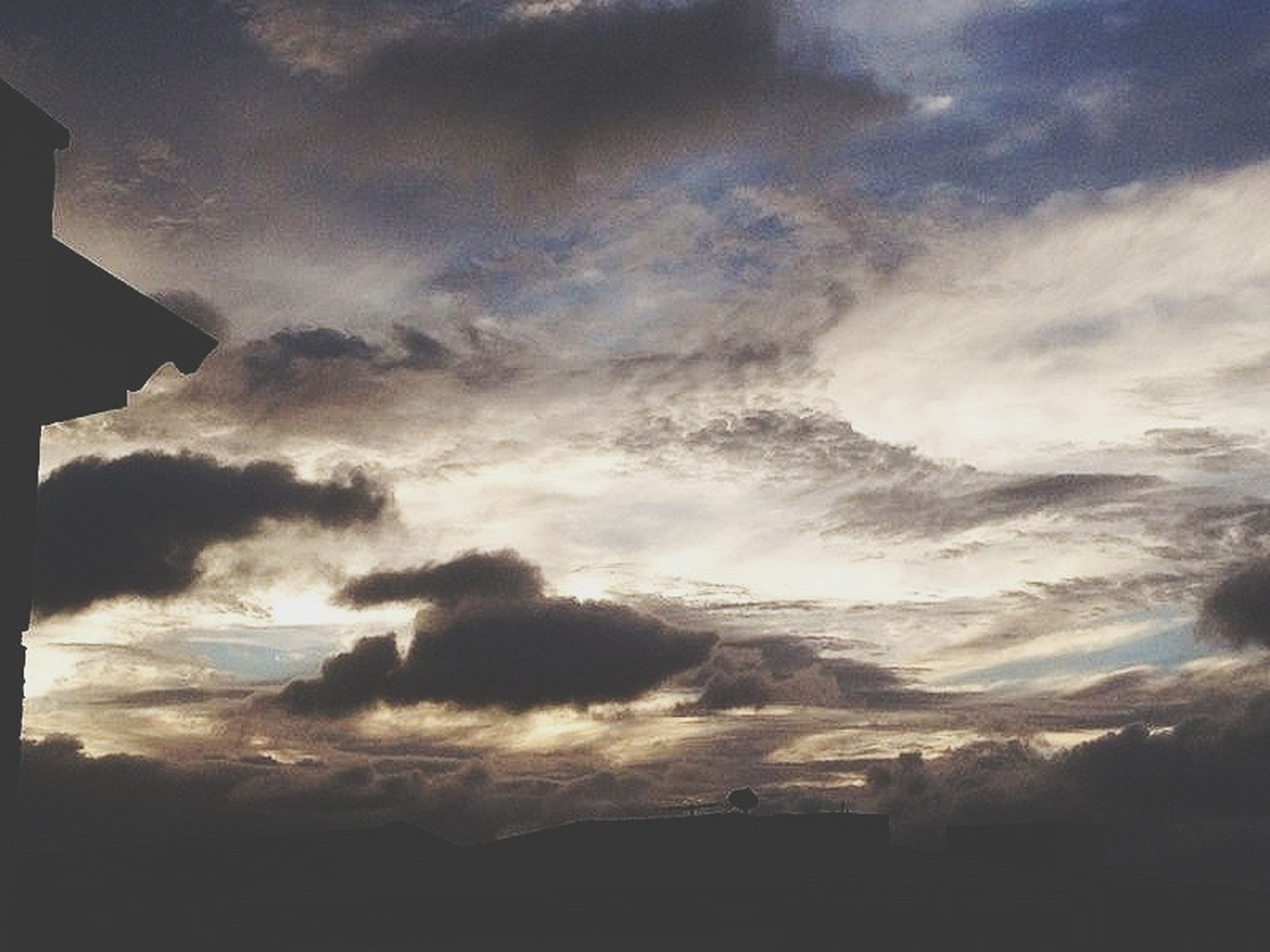 sky, cloud - sky, cloudy, scenics, beauty in nature, silhouette, tranquility, weather, tranquil scene, cloud, nature, overcast, low angle view, cloudscape, sunset, dusk, dramatic sky, storm cloud, idyllic, landscape