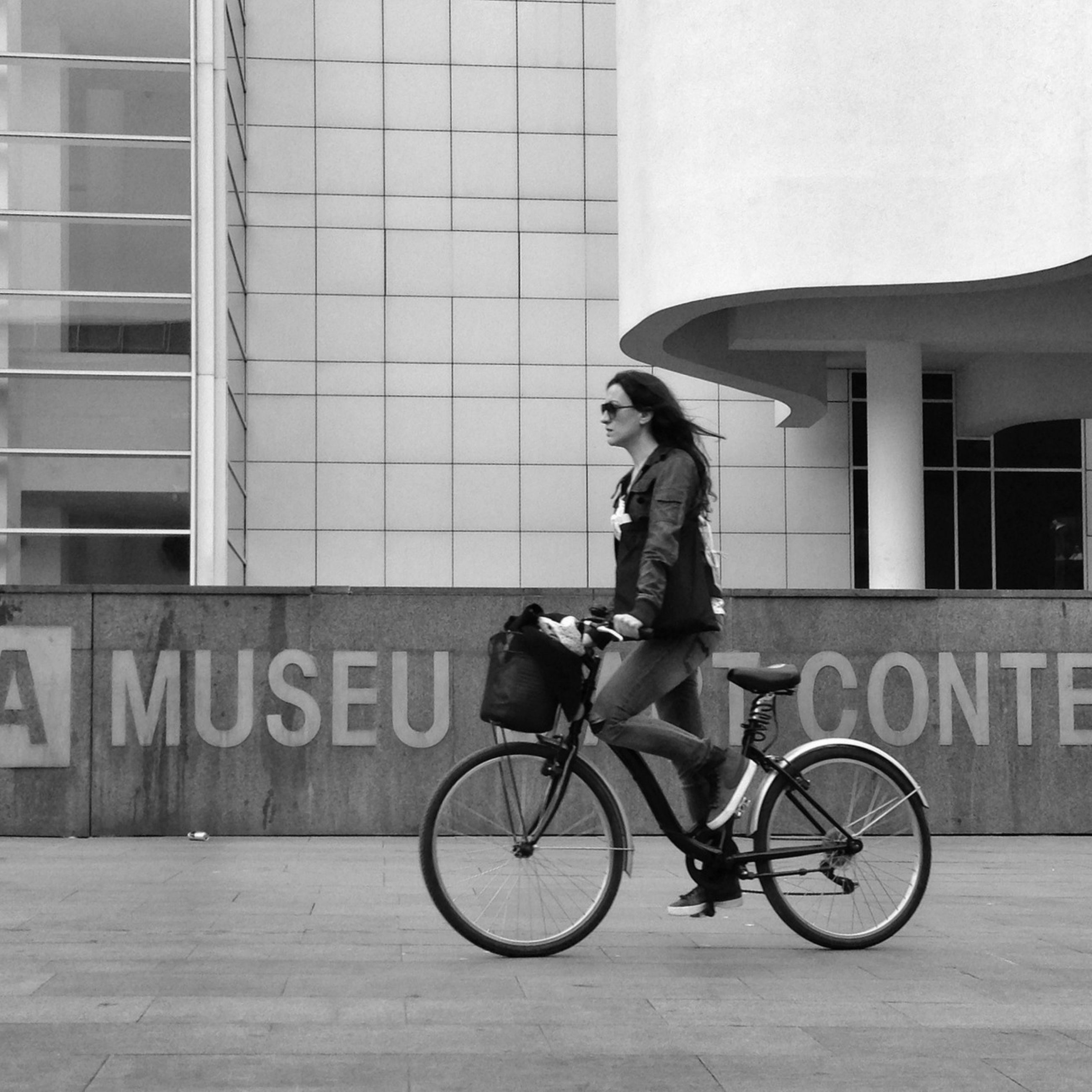 bicycle, transportation, mode of transport, architecture, land vehicle, building exterior, built structure, men, riding, full length, lifestyles, side view, stationary, leisure activity, parking, street, parked, city
