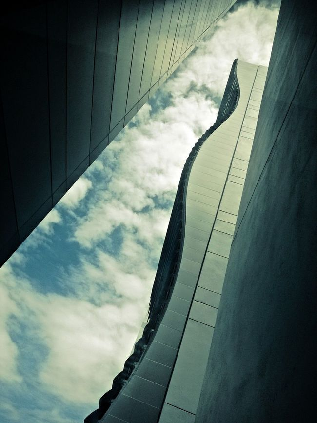 Architecture Building Building Exterior Built Structure Capital Cities  City City Life Cloud Cloud - Sky Cloudy Day Low Angle View Modern No People Office Building Outdoors Sky Skyscraper Tall Tall - High Travel Destinations
