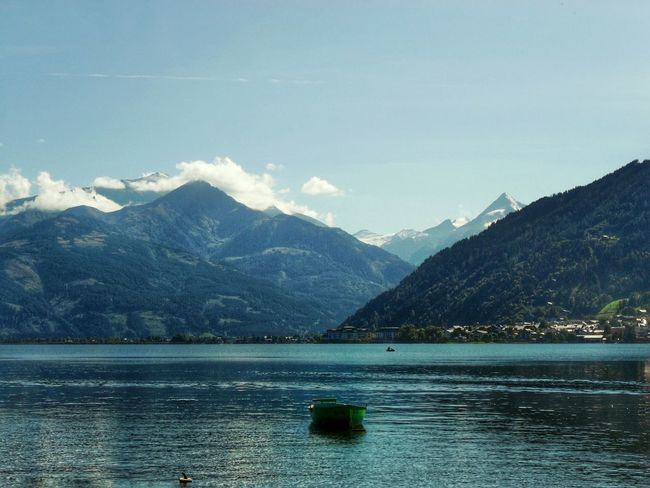 """""""Late afternoon at the lake"""". The Sun already settled down the Mountains. Lake View Lake Boats Lago See Zell Am See Barchetta SalzburgerLand Pinzgau (I think) Point And Shoot plus EyeEm Edited Eyeemfilter Remembrance Austria Alpen Alpi del Salisburghese"""