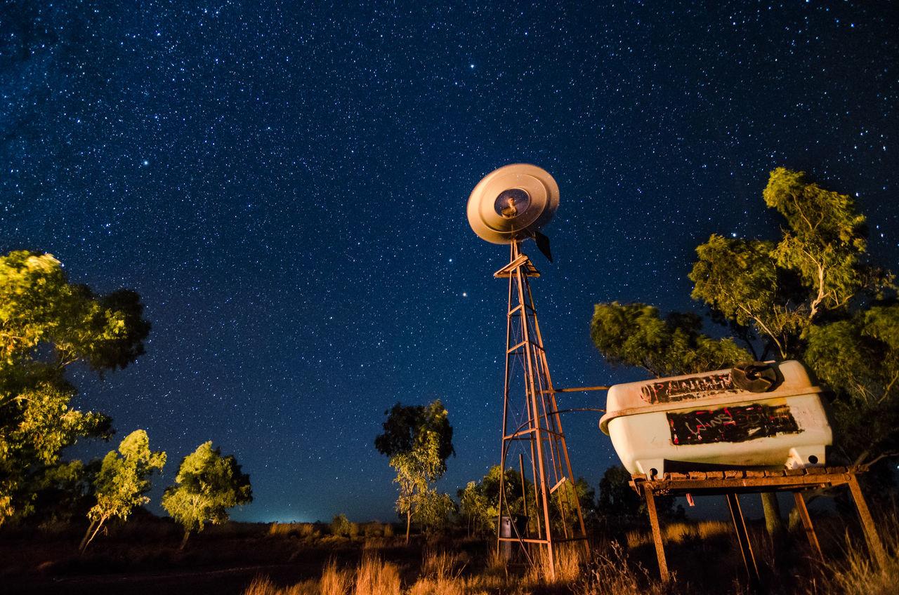 Windmill in Australian Desert Australian Landscape Beauty In Nature Desert Horizon Milky Way Night Scenics Sky Space And Astronomy Star Field Stars Tranquility Trees Watertank Windmills #photography