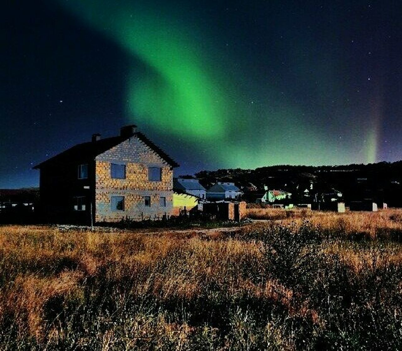 night, built structure, house, architecture, no people, building exterior, dramatic sky, grass, green color, aurora polaris, outdoors, illuminated, sky, tranquility, star - space, scenics, landscape, nature, beauty in nature, astronomy