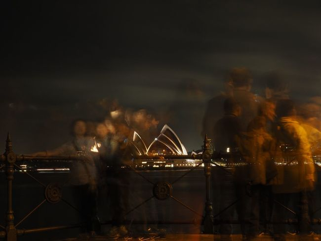 Long exposure of tourists taking pictures with Sydney Opera House in the background City Coming And Going Ghost Illuminated Long Exposure Movement Night Outdoors Selfie Tourist Tourist Attraction  Tourists