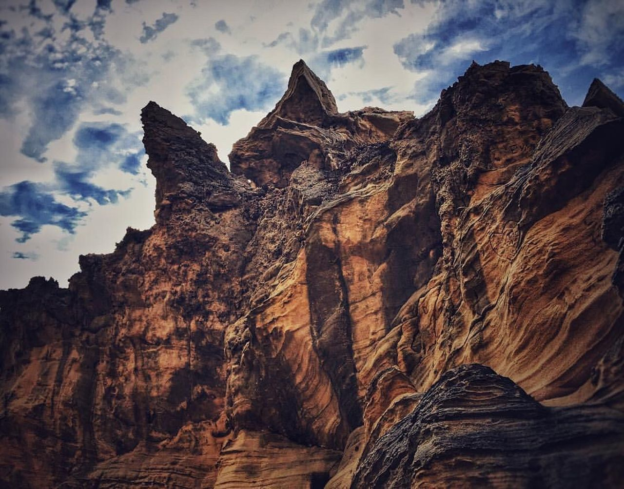 mountain, rock formation, sky, nature, no people, physical geography, beauty in nature, cliff, day, scenery, landscape, scenics, peak, outdoors, height