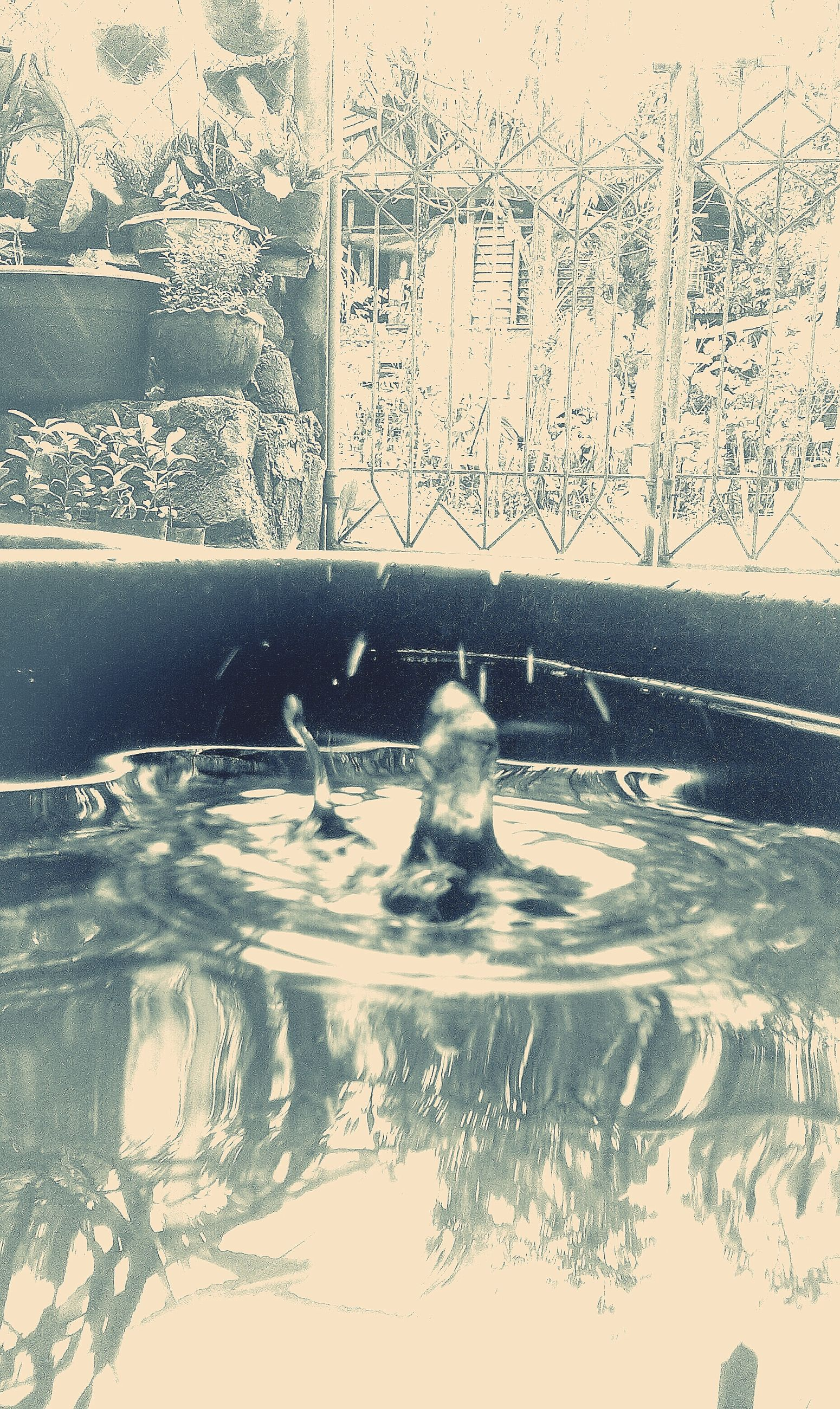 water, splashing, wet, motion, close-up, glass - material, transparent, window, drop, creativity, art, art and craft, fountain, cold temperature, season, day, human representation, reflection, wall - building feature, winter