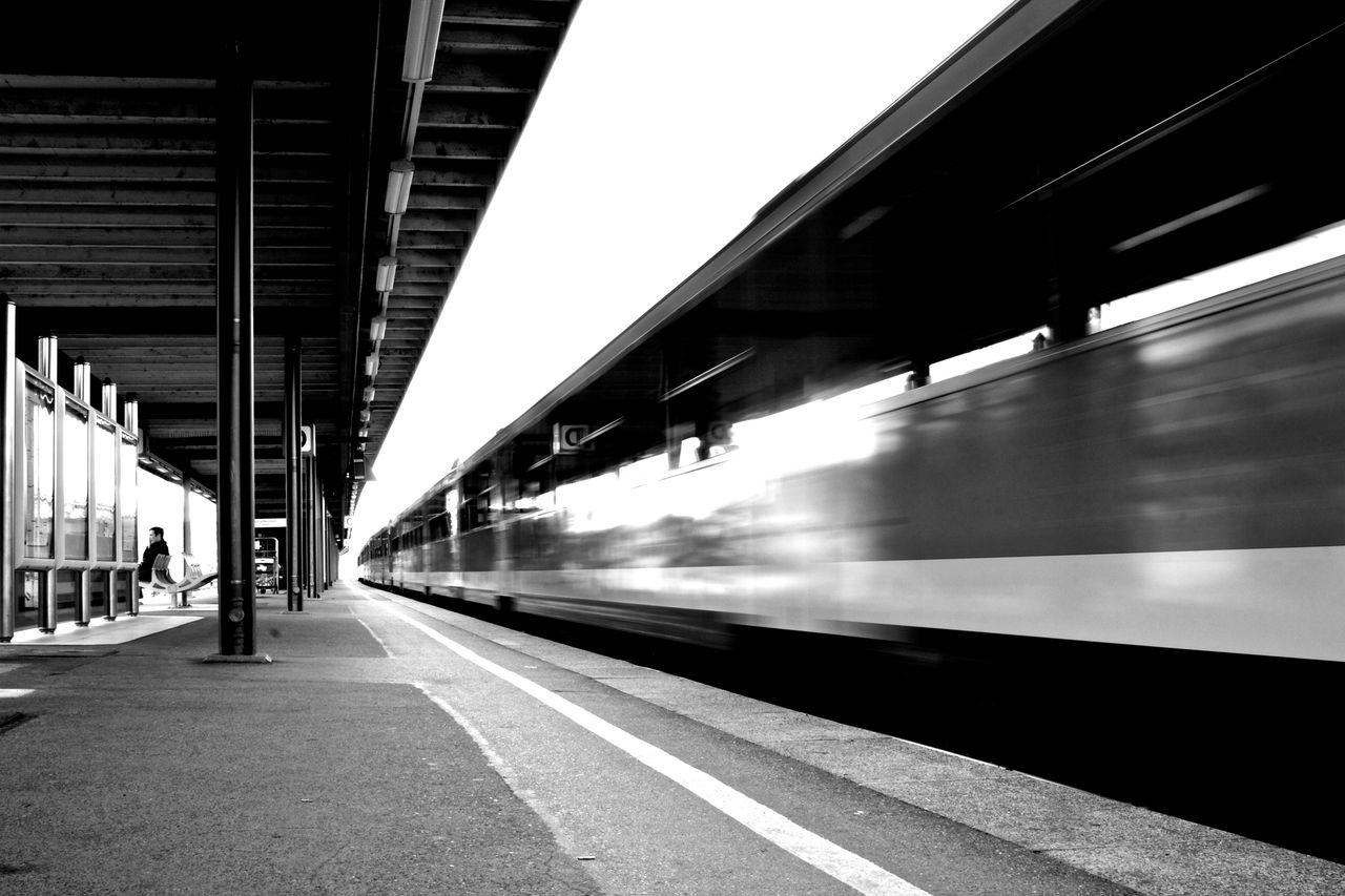 Blurred Motion Commuter Train Day Journey Mode Of Transport Motion No People Outdoors Passenger Train Public Transportation Rail Transportation Railroad Station Railroad Station Platform Speed Subway Train Train - Vehicle Transportation