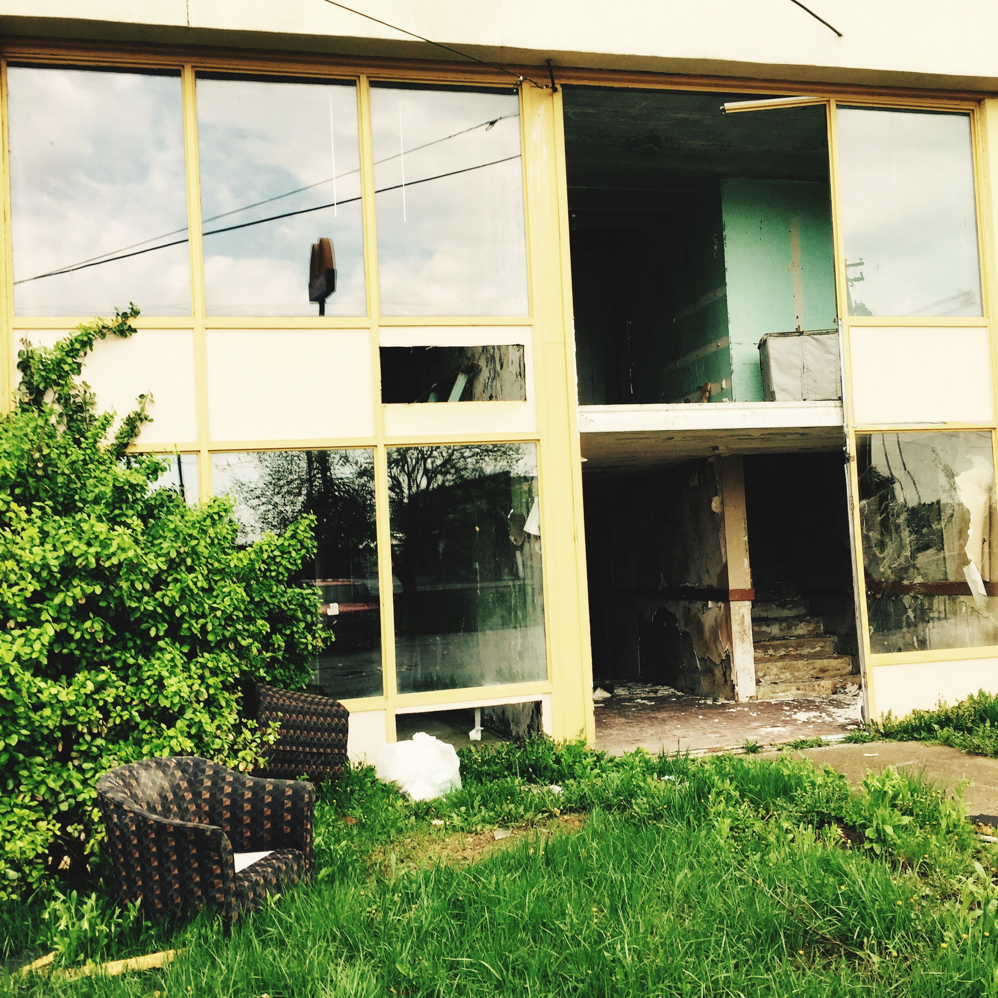 architecture, building exterior, built structure, window, house, residential structure, abandoned, residential building, building, glass - material, grass, plant, low angle view, day, outdoors, damaged, old, transfer print, exterior, no people