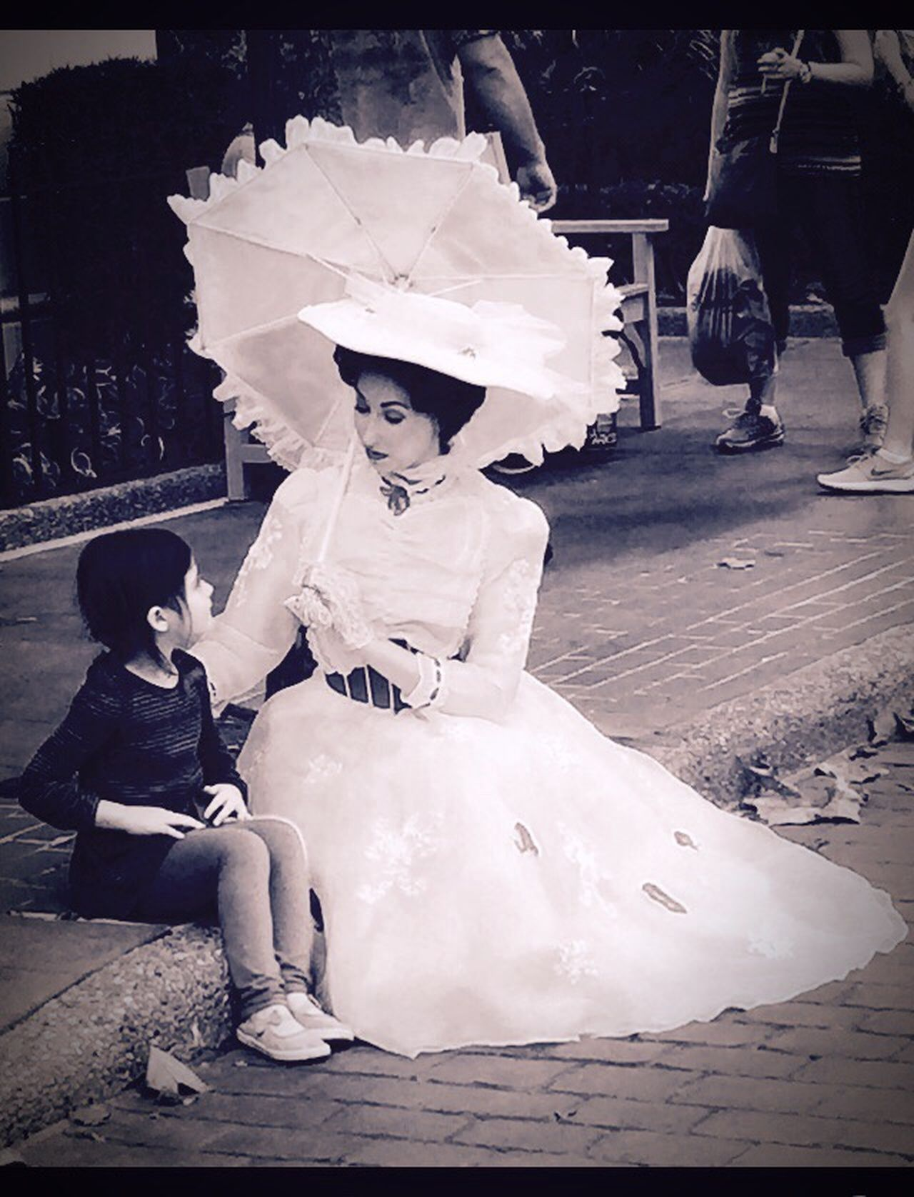 Little girl chatting with Mary Poppins Child Two People Sitting Outdoors Mary Poppins DisneyWorld Marypoppins Mary Poppins Collection Justaspoonfullofsugar Little Girl Chat Chatting Idol Etiquette Vintage Vintage Lens Vintage Moments Magiccarpetbag Umbrella Disney Epcot