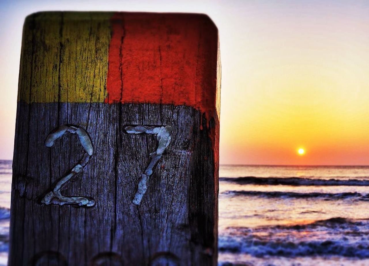 sea, wood - material, sunset, no people, outdoors, horizon over water, nature, water, close-up, beauty in nature, sky, scenics, day