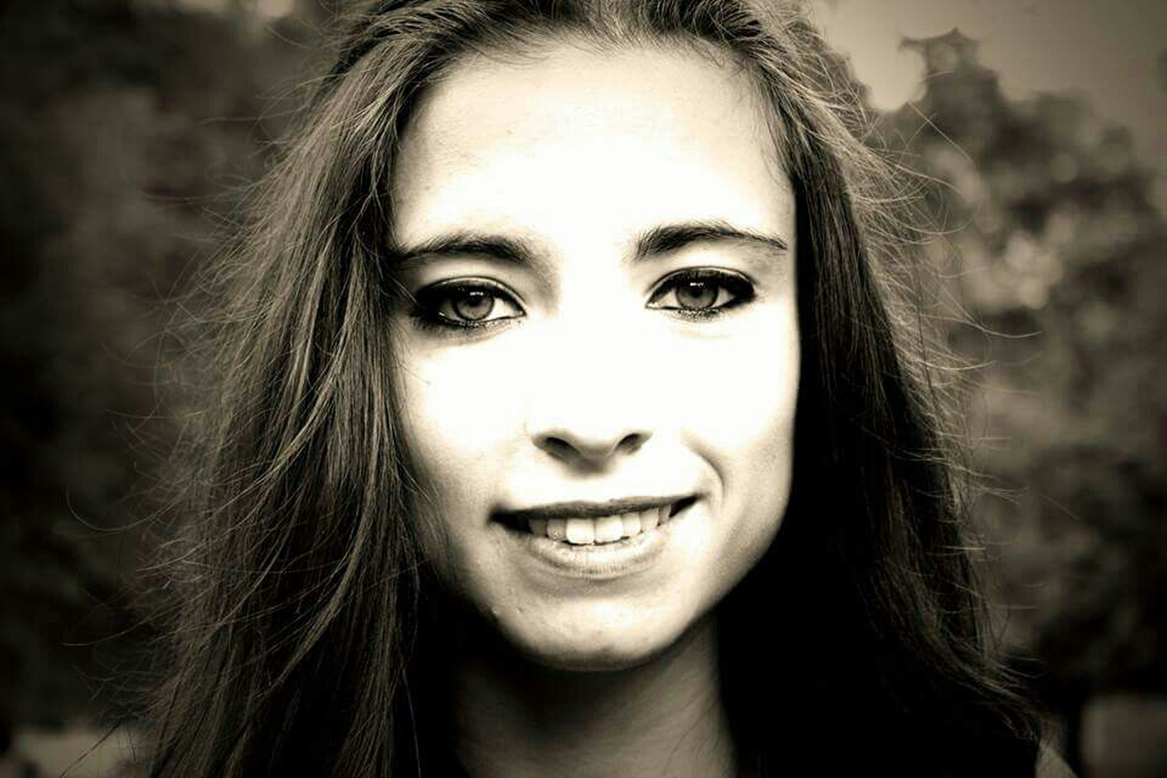 headshot, young adult, looking at camera, portrait, person, young women, long hair, close-up, lifestyles, front view, human face, focus on foreground, leisure activity, smiling, beauty, contemplation, head and shoulders