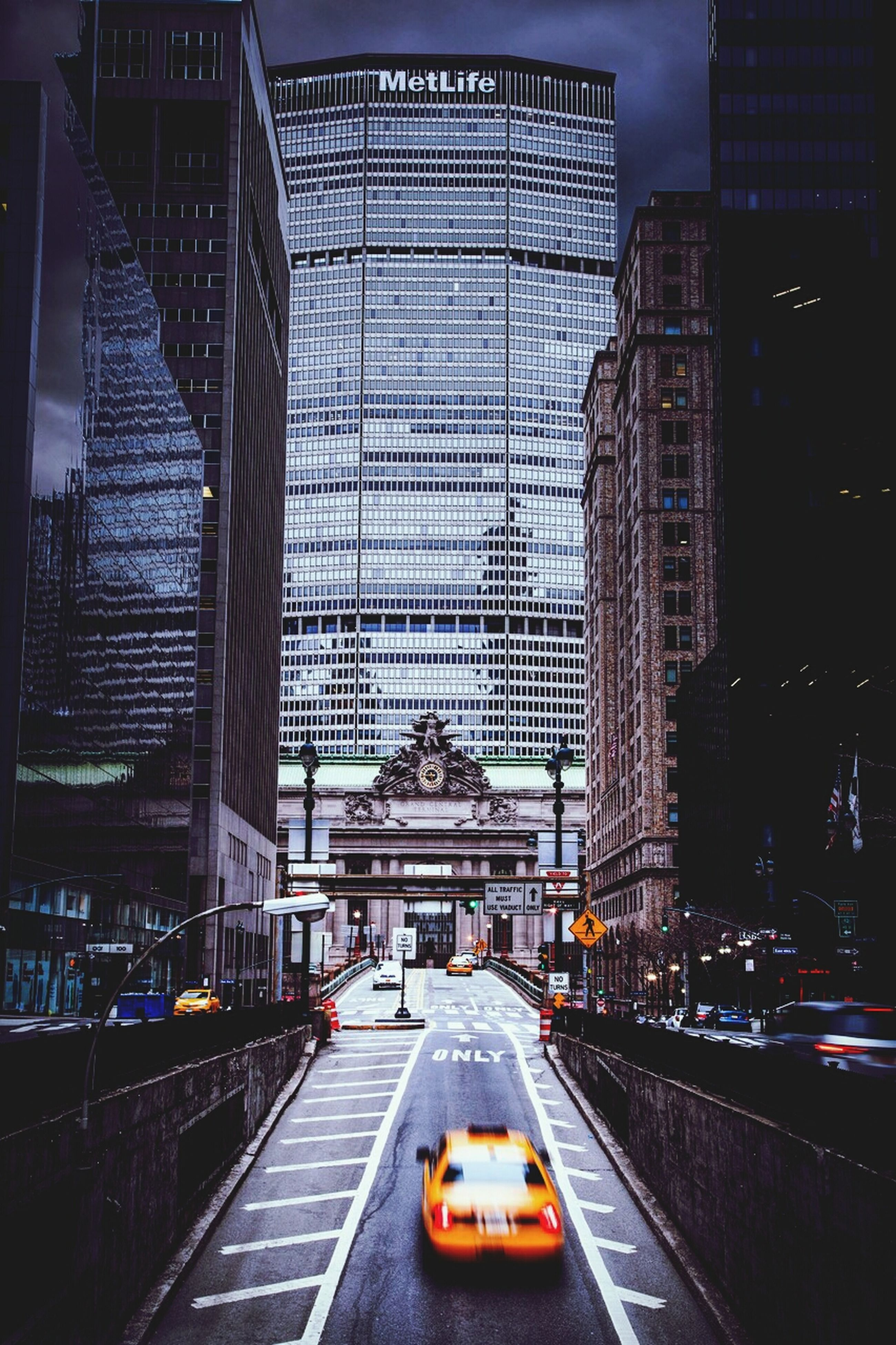 architecture, built structure, building exterior, transportation, city, car, mode of transport, land vehicle, road, travel, street, illuminated, city life, the way forward, capital cities, travel destinations, city street, incidental people, building, famous place