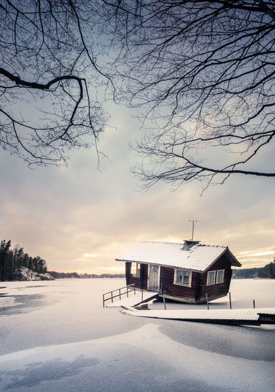 Abandoned and old cottage with winter landscape in southern Finland Abandoned Beauty In Nature Blue Building Cloudy Cold Temperature Cottage Decay Frost Frozen Ice Landscape Nature No People Outdoors Pier Sauna Snow Sunset Tree White Winter Winter Time Worn Out