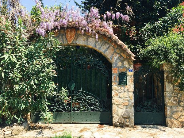 Beautiful wrought iron gate entrance to the house in Marmaris, Turkey Home Turkey Arch Architecture Building Exterior Built Structure Buy Day Entrance Flower Growth House Marmaris Nature No People Outdoors Plant Real Estate Sell Villa Wrought Iron Wrought Iron Design Wrought Iron Gates