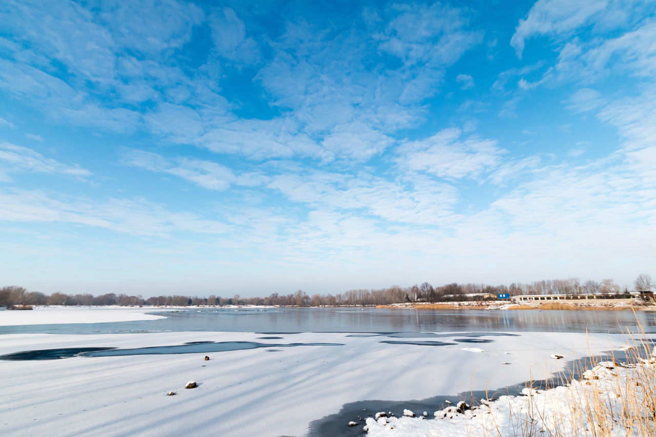 Scenic View Of Lake Against Blue Sky During Winter