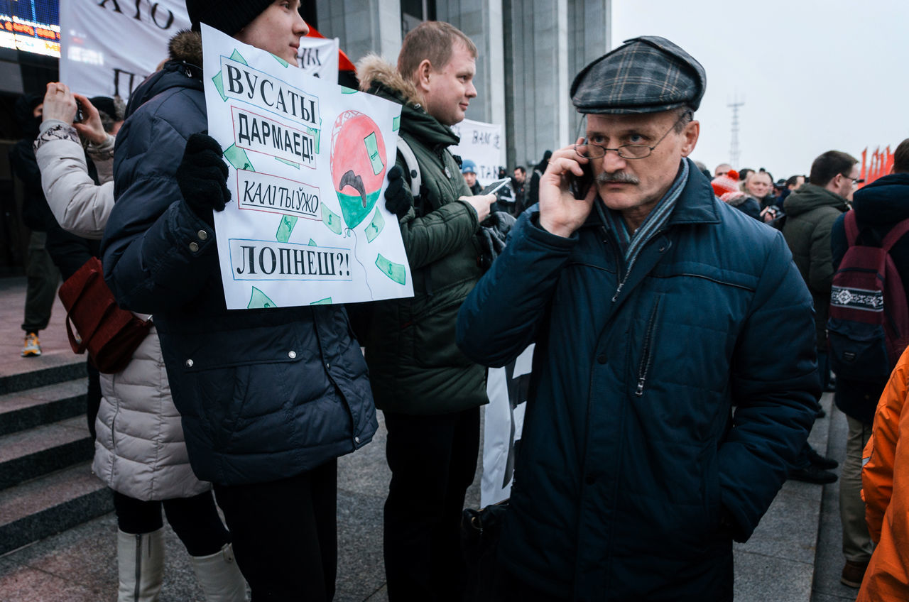 Minsk, Belarus - February 17, 2017 - Belarusian people participate in the protest against the decree 3 'On prevention of social parasitism' of President Lukashenko in the center of Minsk Adult Adults Only Belarus Demonstration Marching Participant People Politics Protest Protesters Protesting Rally Social Issues